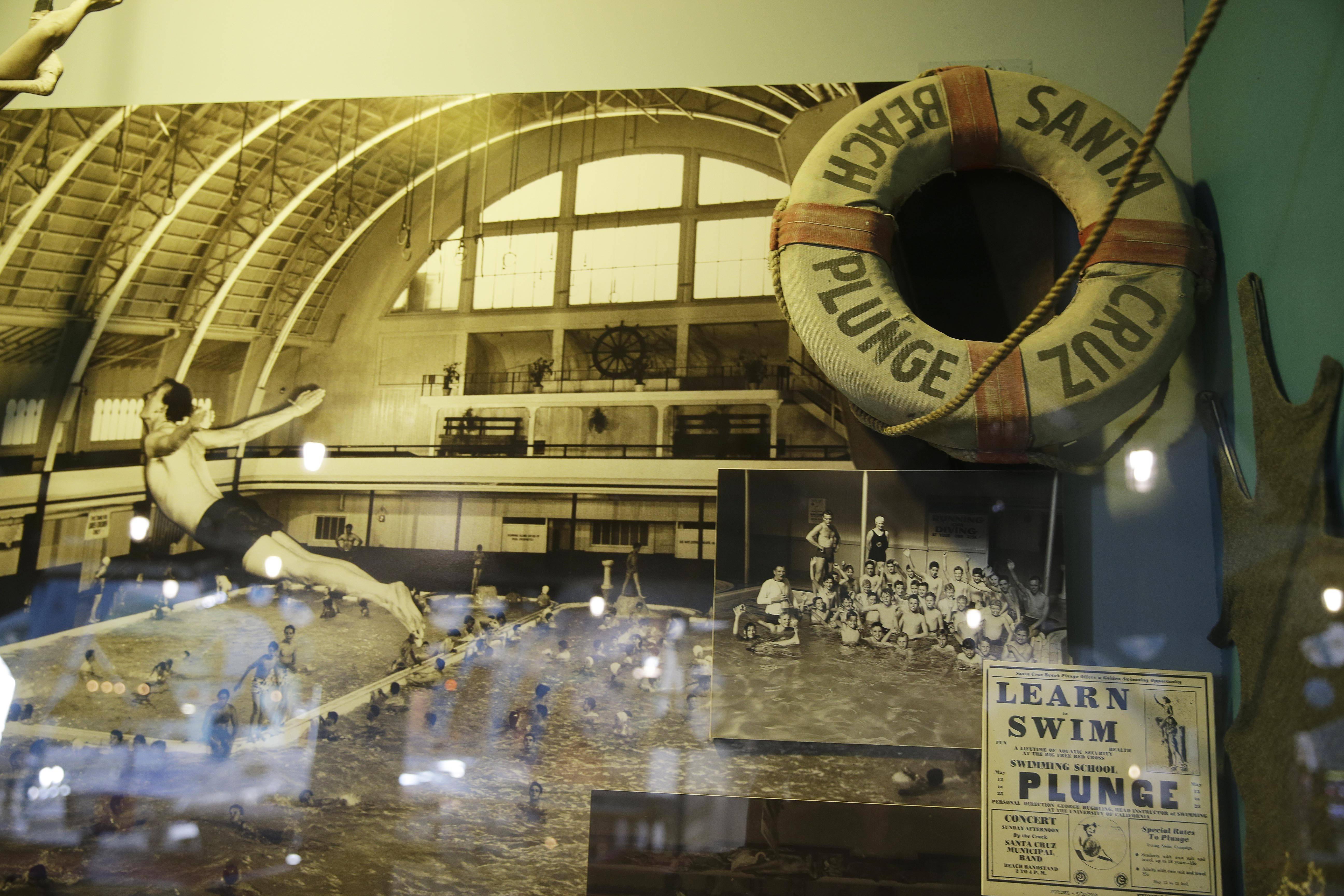 A historic display inside the Neptune's Kingdom amusement center shows items from when the building housed a natatorium on the Santa Cruz Beach Boardwalk in Santa Cruz, Calif. The natatorium was one of the largest indoor, heated, salt water pools on the west coast and was called The Plunge. Each summer thousands would be attracted to the water carnival in the pool.