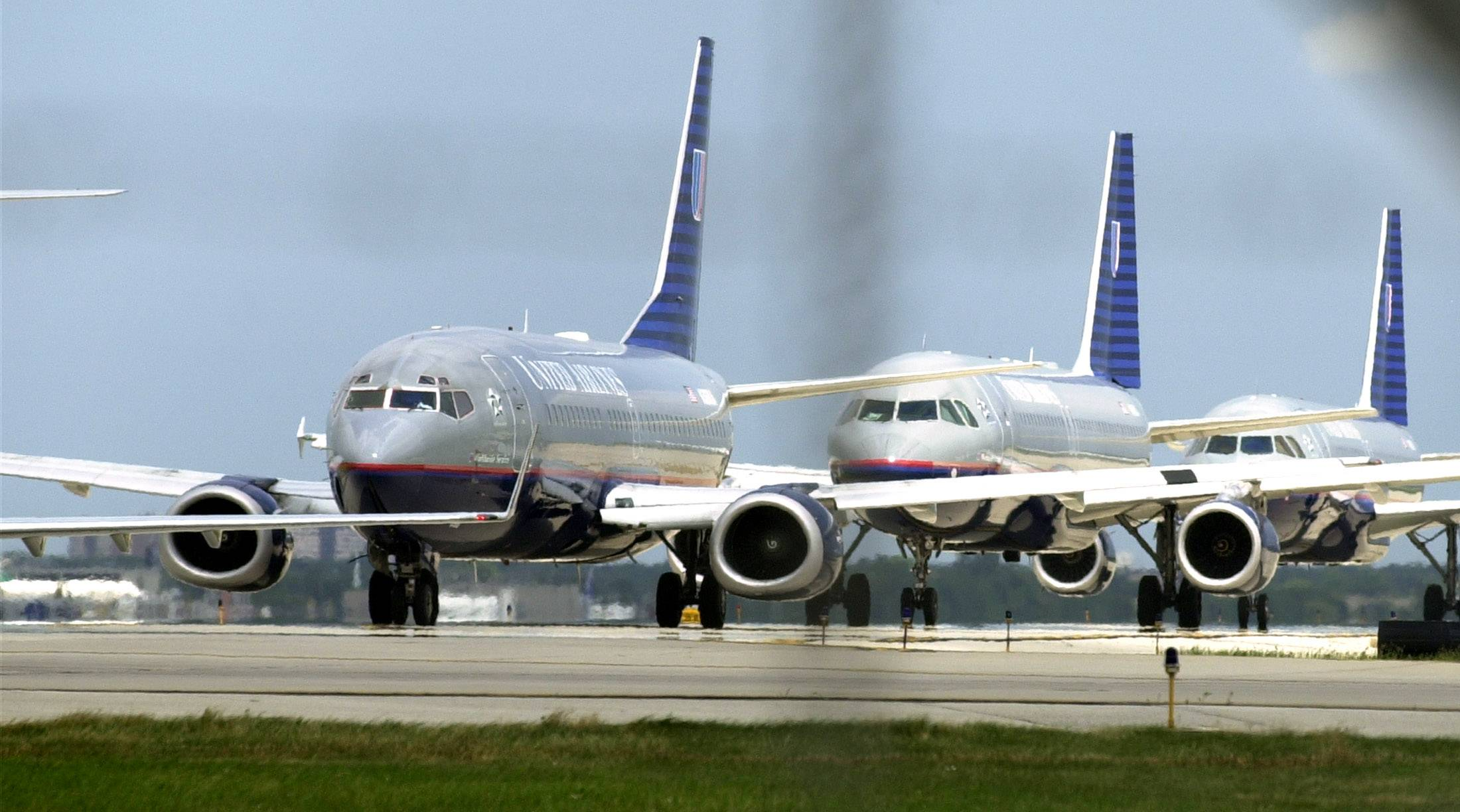 United Airlines planes Line up for Take Off at O'Hare International Airport.