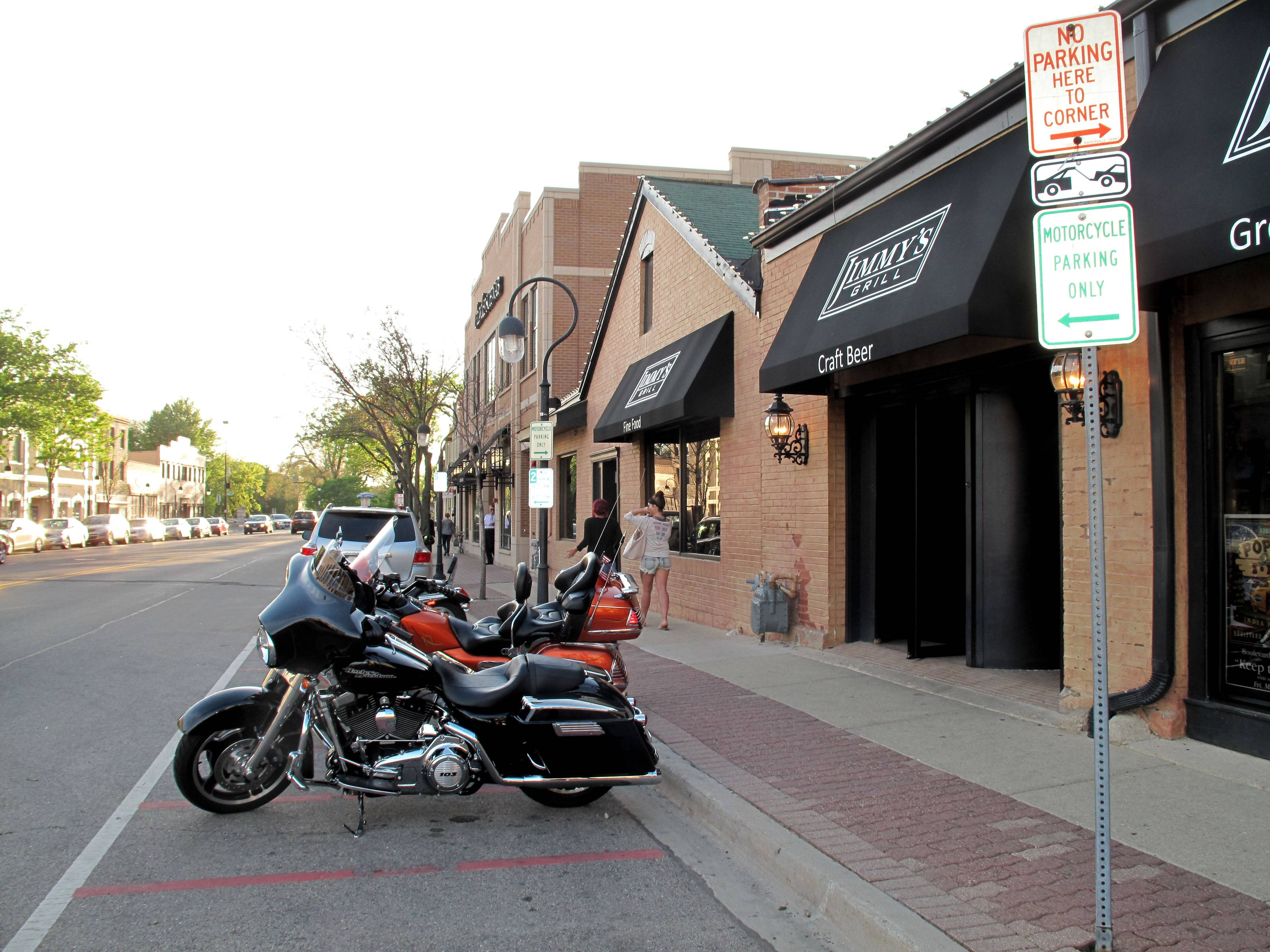 Naperville will be moving eight motorcycle parking spots from Chicago Avenue outside the entrance of Jimmy's Grill to Jackson Avenue near a city parking lot east of Egg Harbor Cafe after the manager of Jimmy's complained of noise and exhaust problems from the bikes.