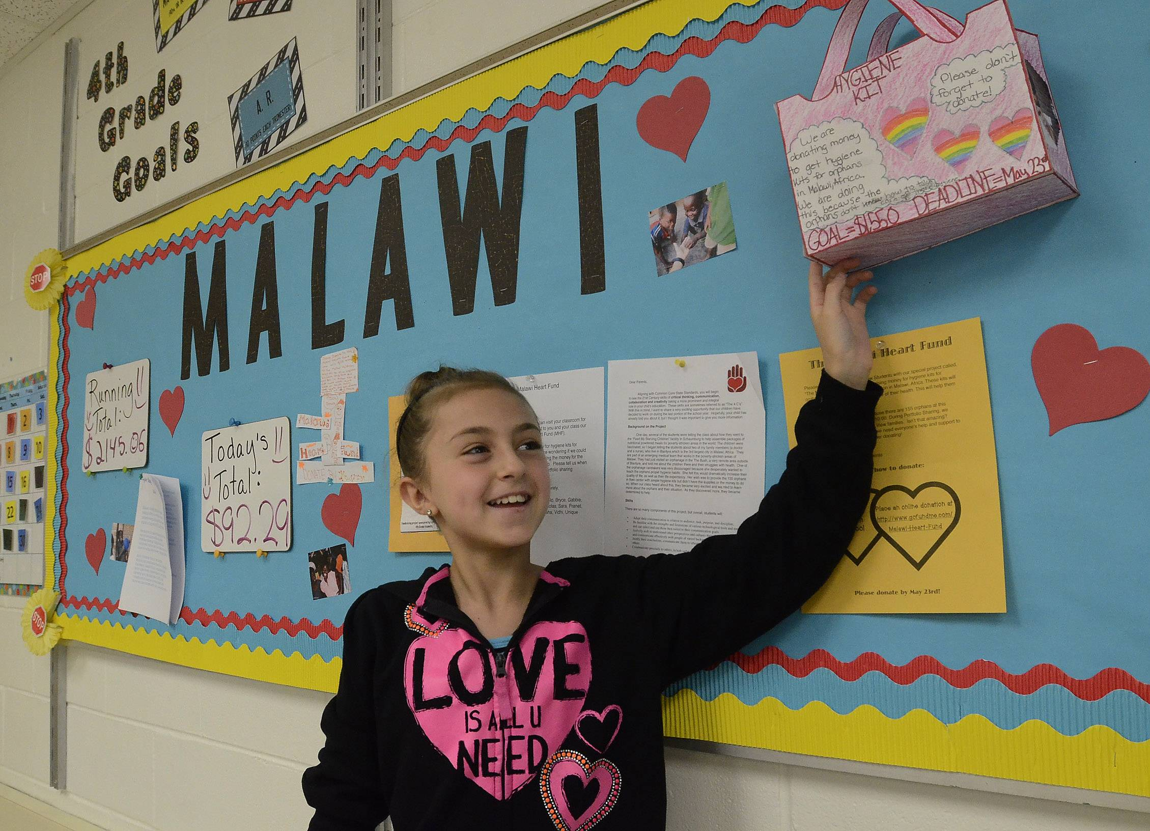 Sara Mavric shows off her hygiene kit poster used by the fourth-grade class.