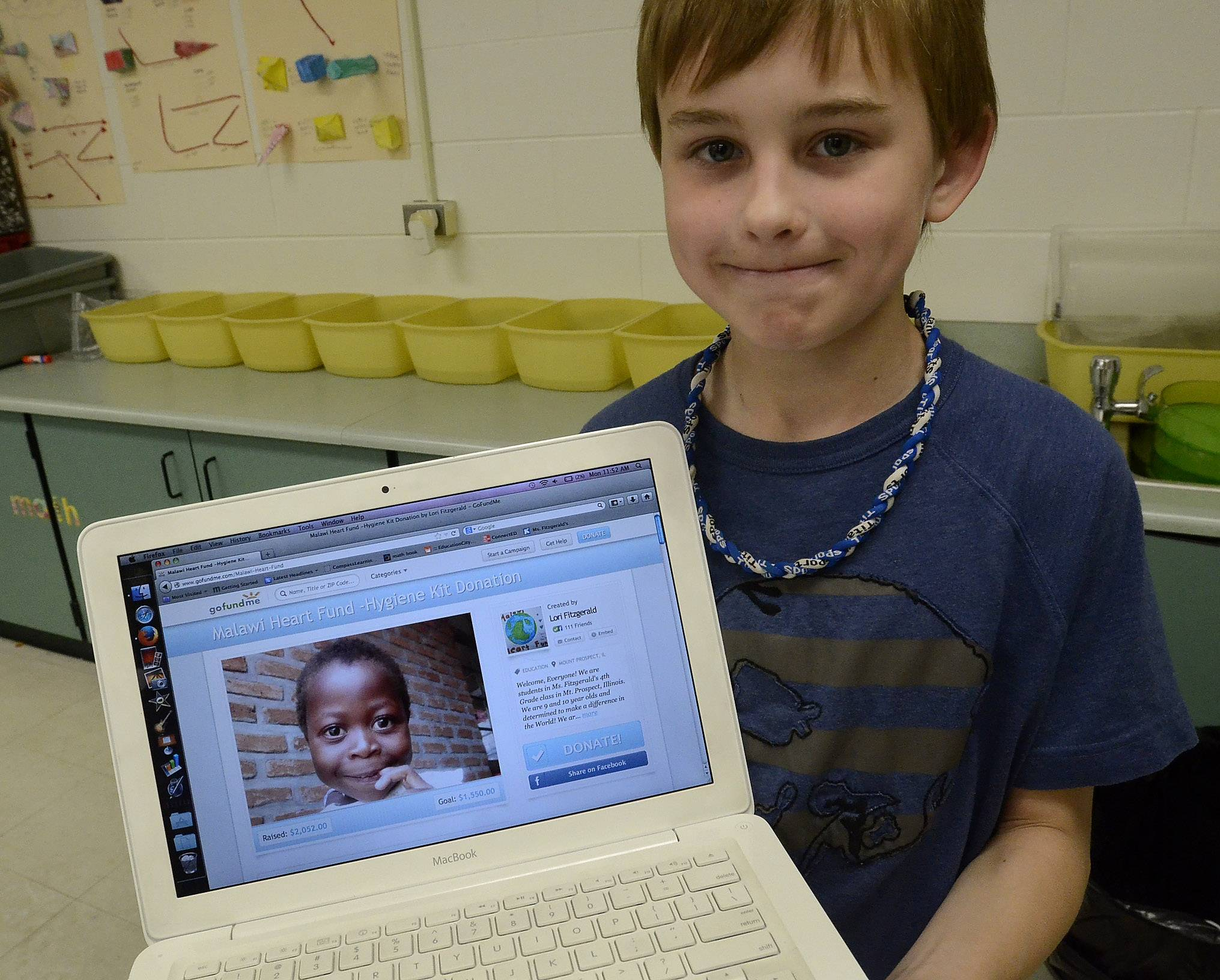 Matthew Christerson shows the website his class is using to raise money for their special project.