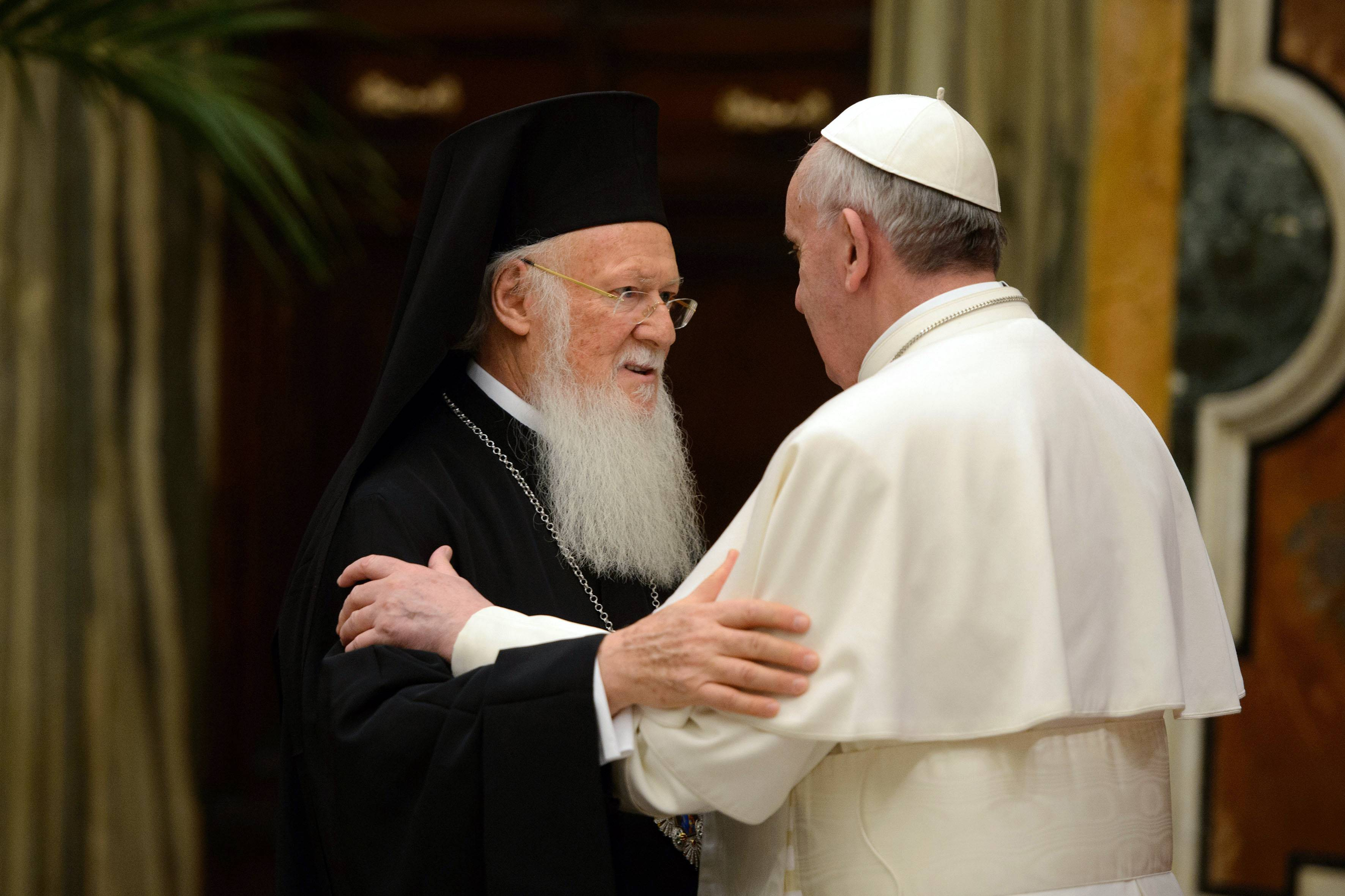 Pope Francis meets Bartholomew I, the first ecumenical patriarch to attend the installation of a Pope since the Catholic and Orthodox church split nearly 1,000 years ago, at the Vatican.