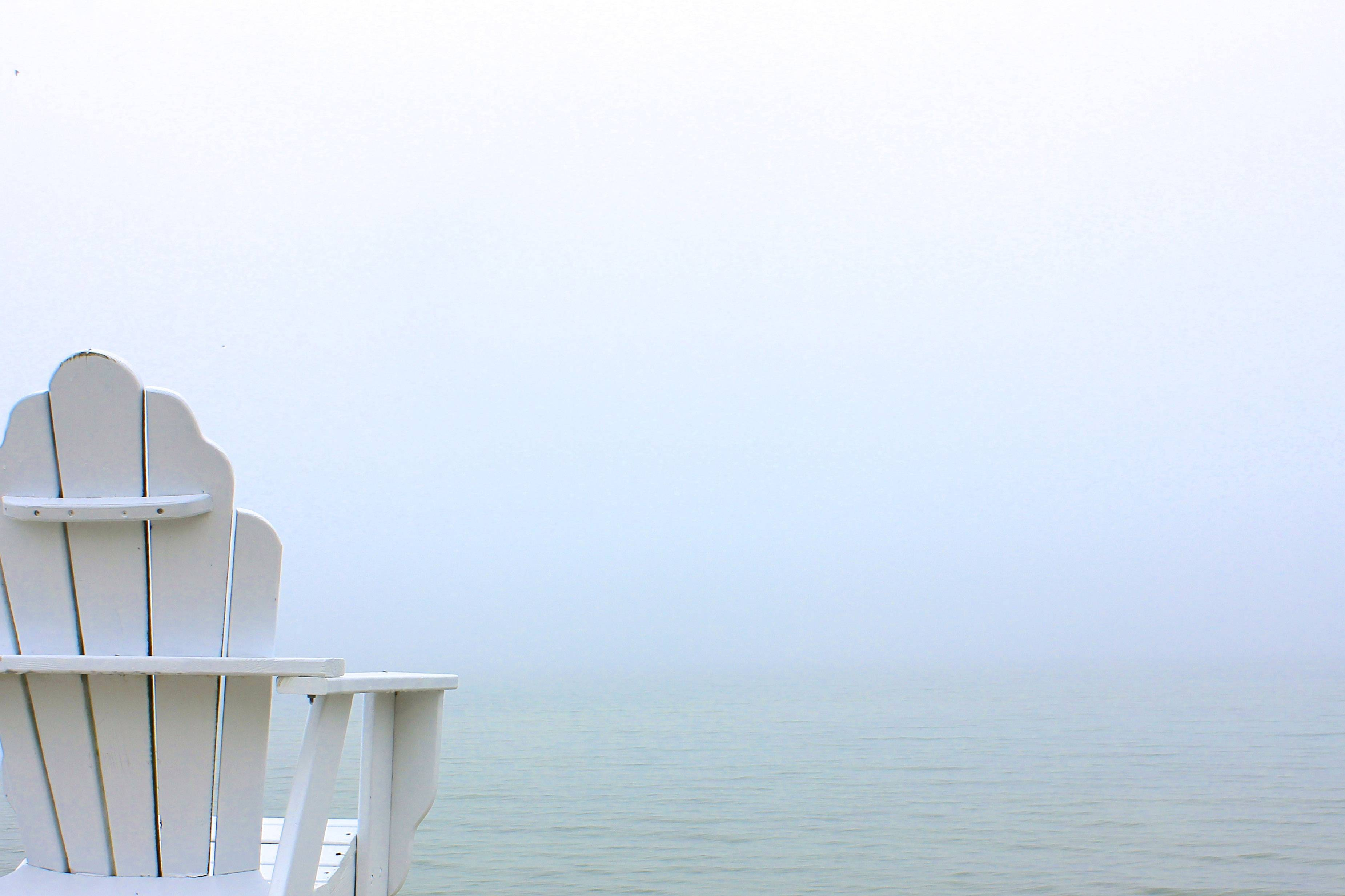 An andirondack chair sits empty on a pier in Ephraim, Wisconsin on a cold and extremely foggy Monday morning on May 12.