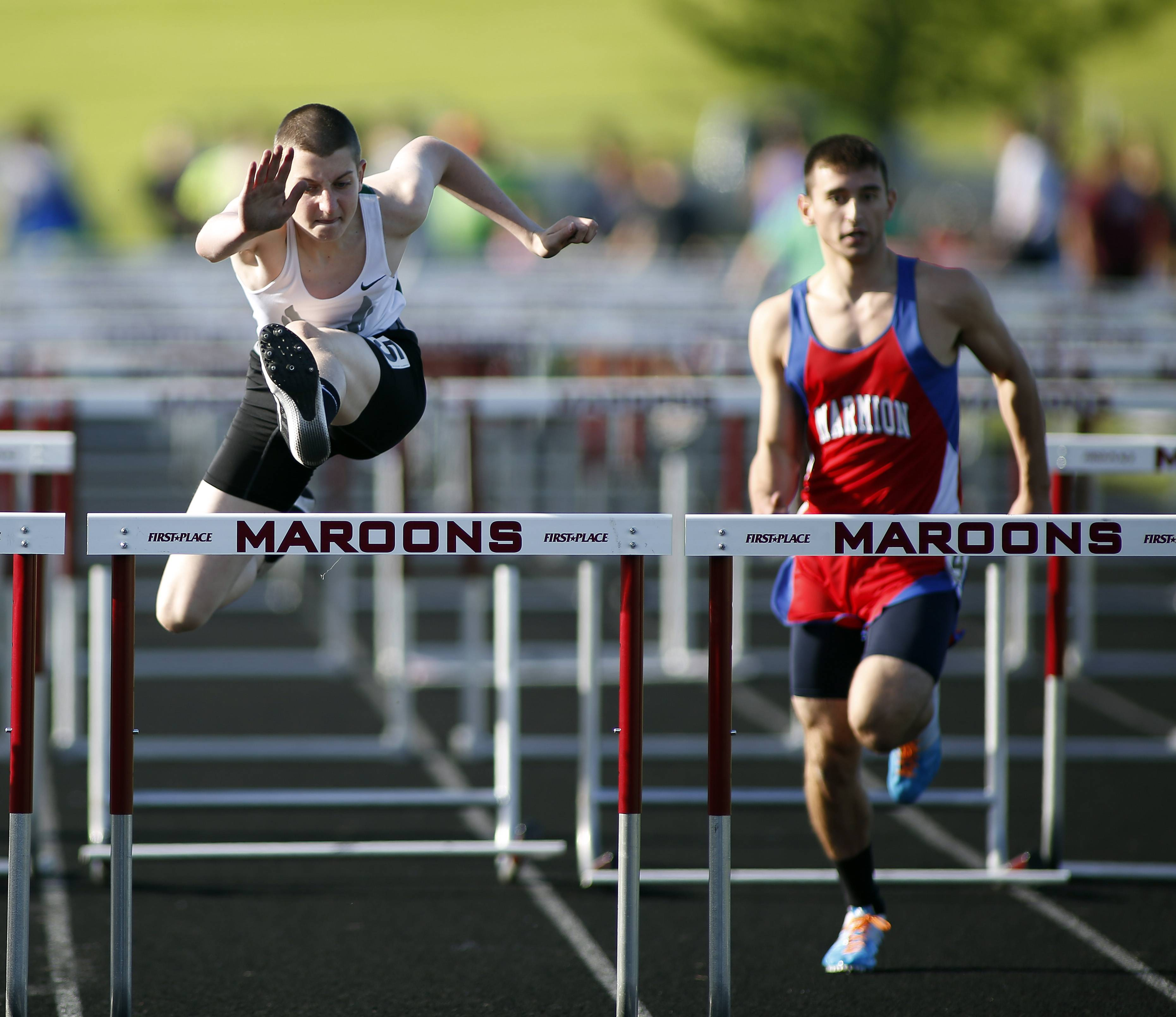 Bartlett's Pat Karys and Marmion's Seth Sevenich compete in the 110 hurdles during the Class 3A Bartlett boys track sectional Friday at Memorial Field in Elgin.