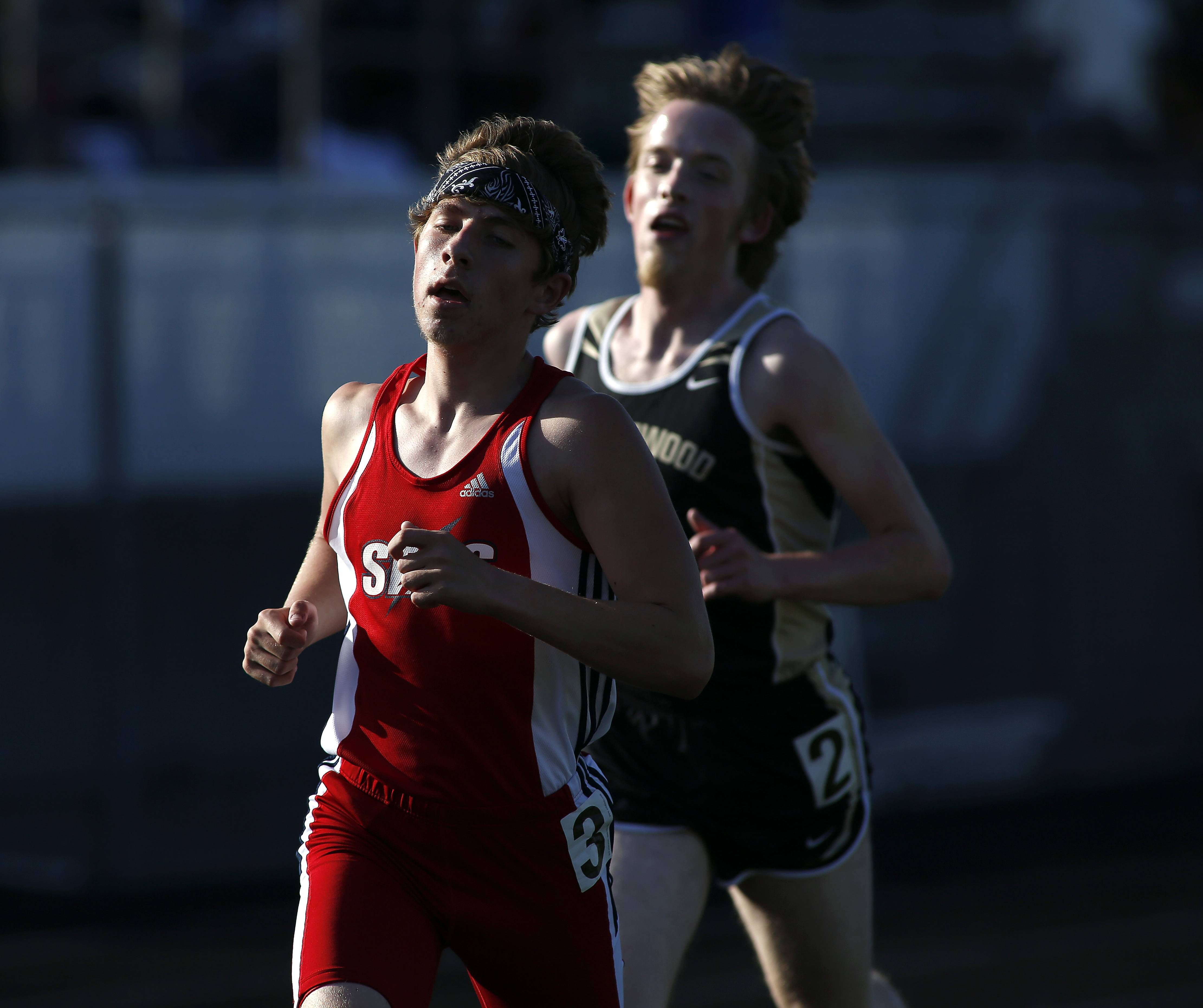 South Elgin's Matt Stover noses ahead of Streamwood's Alan Douglas in the 3,200 during the Class 3A Bartlett boys track sectional Friday at Memorial Field in Elgin.