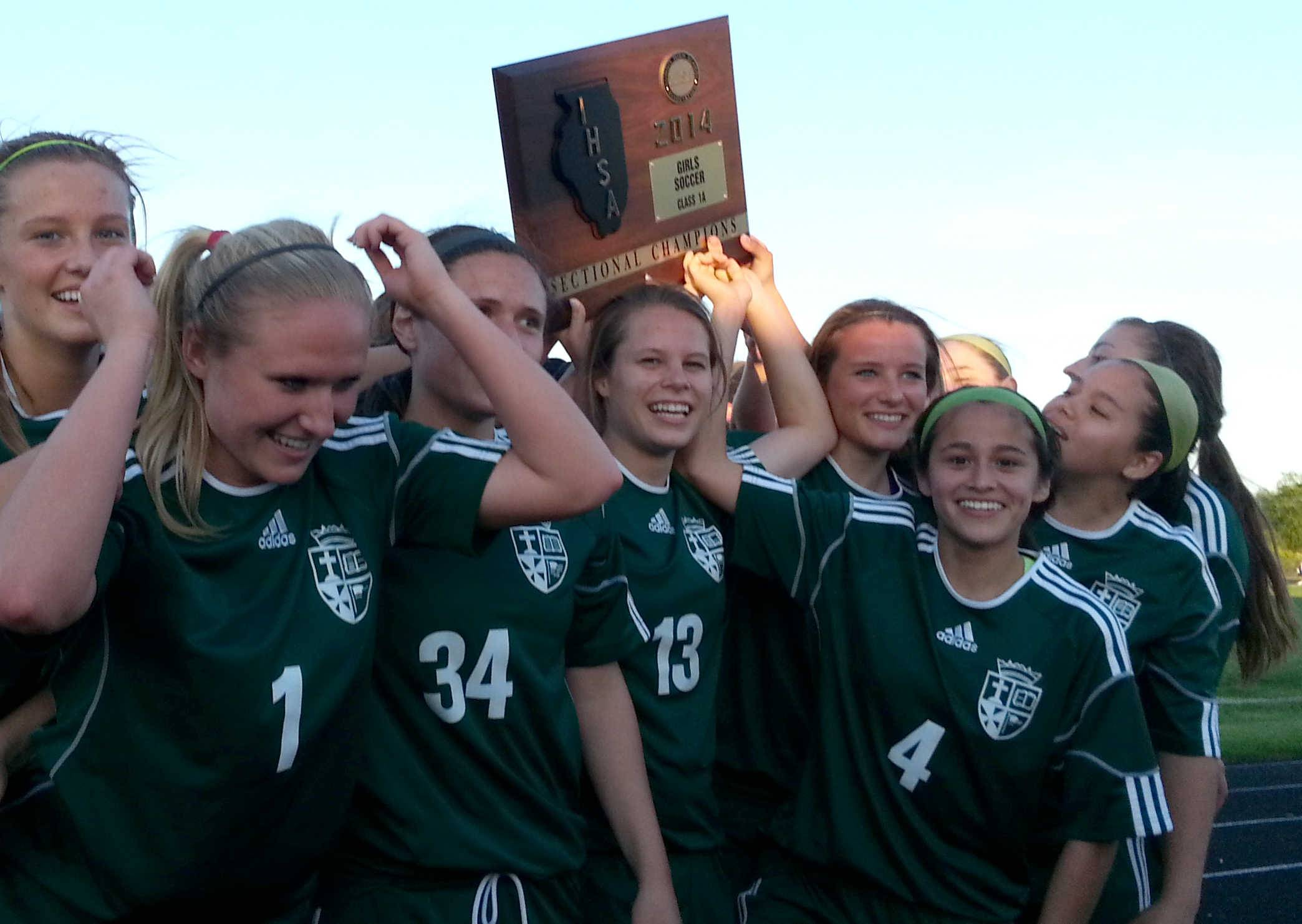 St. Edward's soccer team celebrates its Class 1A sectional championship at Richmond-Burton on Friday night.