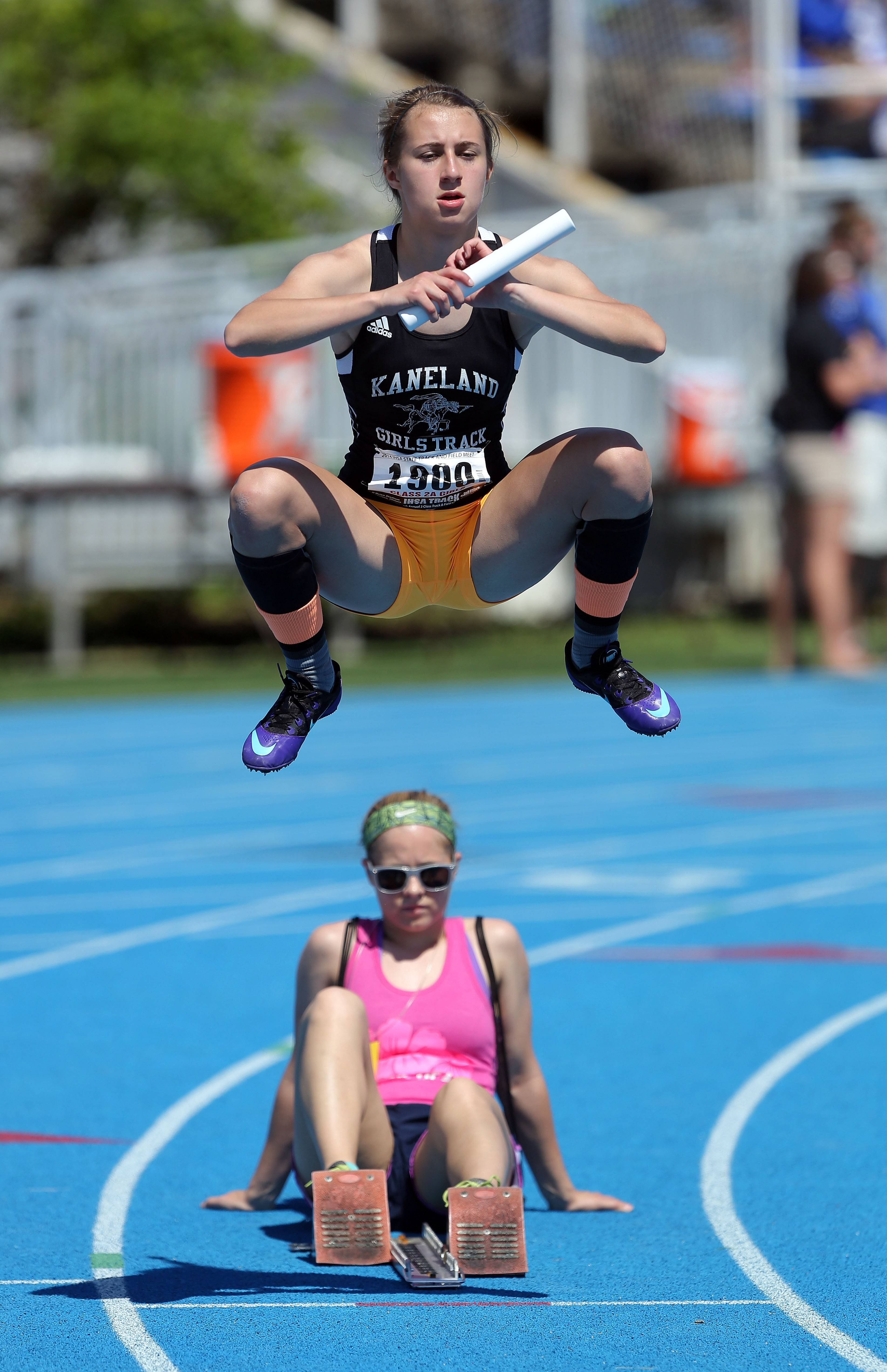 Kaneland's Olivia Galor warms up before the 4x200-meter relay during the prelims of the girls track and field state meet at Eastern Illinois University in Charleston Friday.