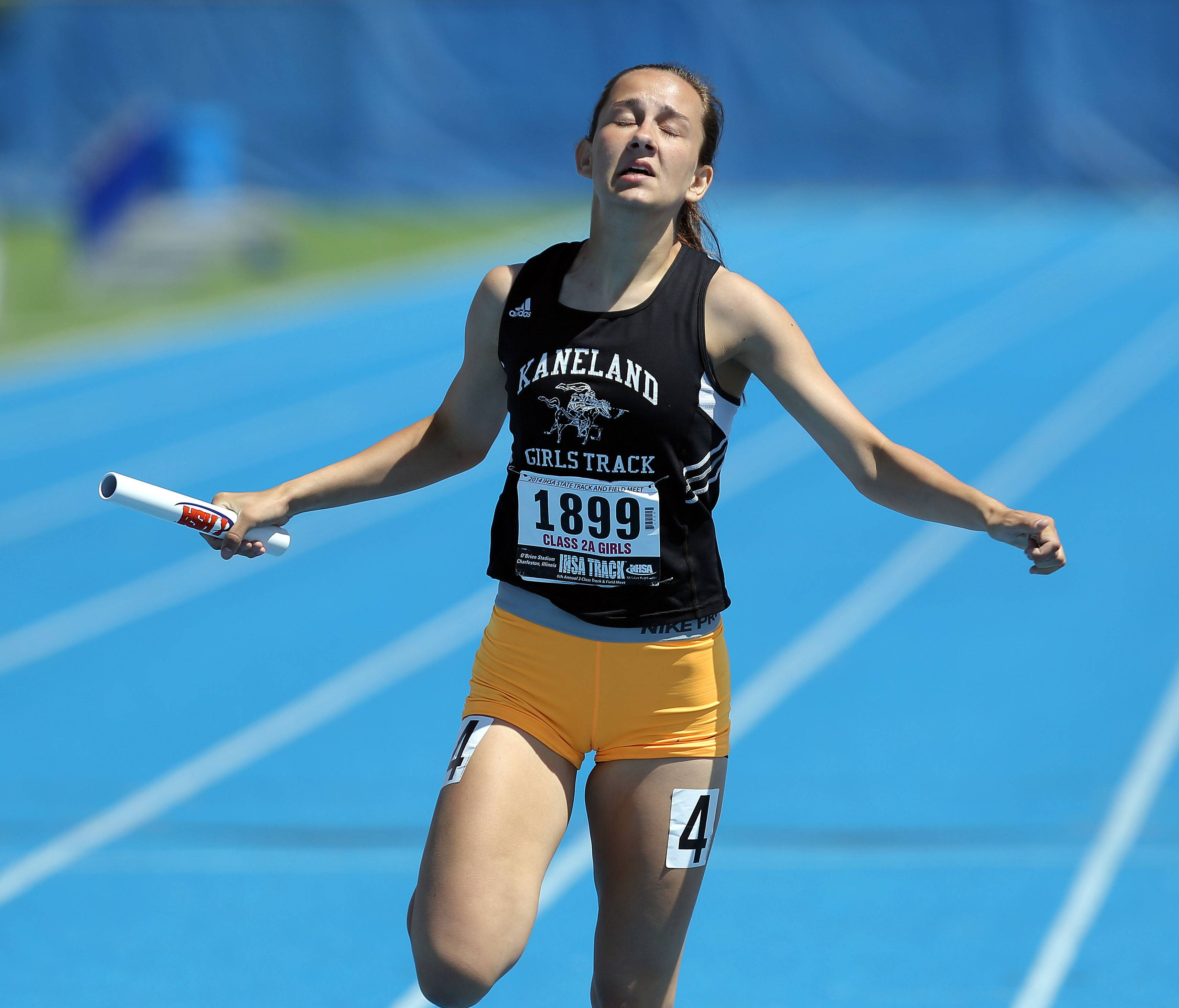 Kaneland's Carly Elliott crosses the finish line in the 4x200-meter relay during the prelims of the girls track and field state meet at Eastern Illinois University in Charleston Friday.