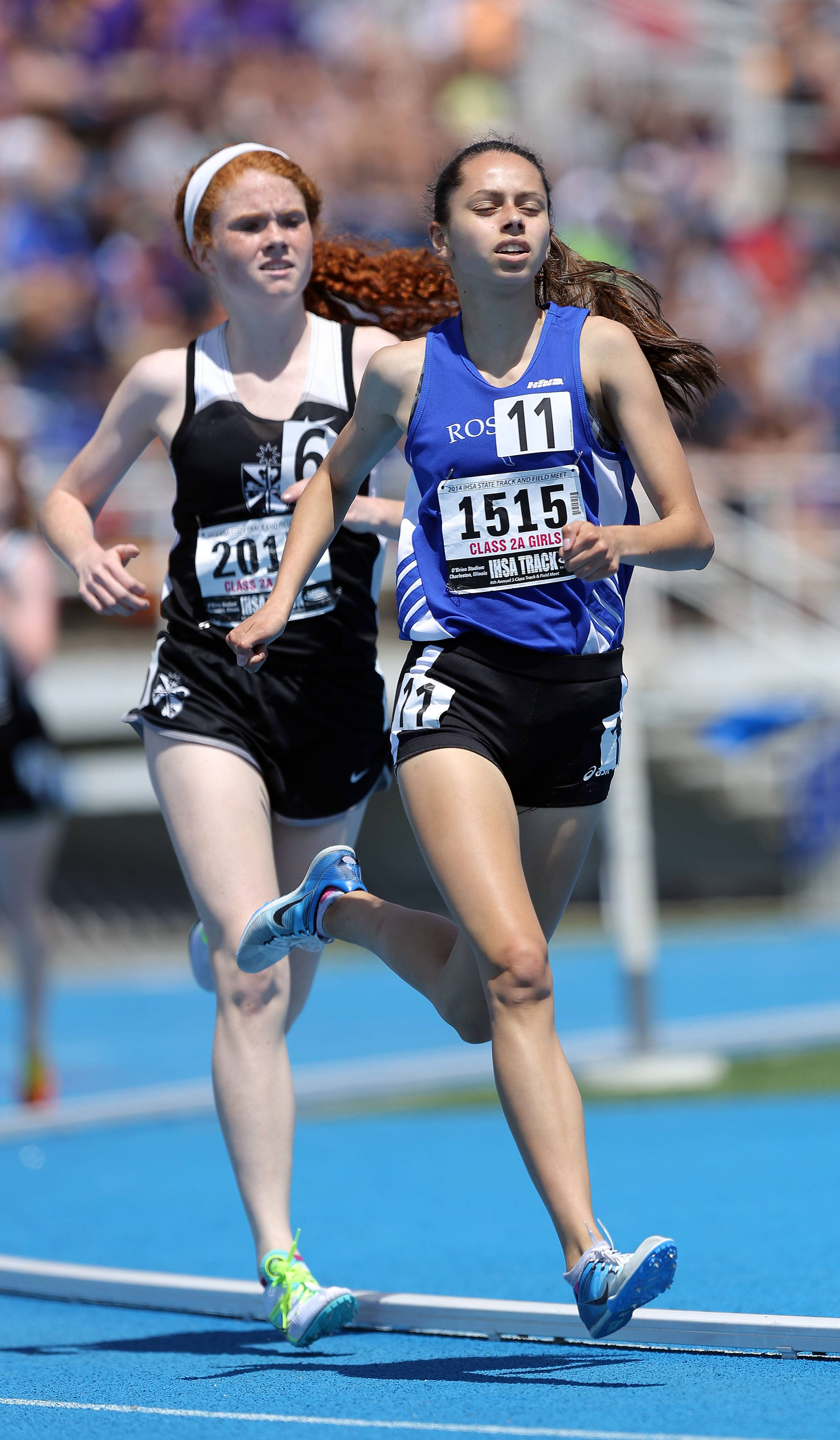 Rosary's Madison Ronzone runs in the 1600-meter run during the prelims of the girls track and field state meet at Eastern Illinois University in Charleston Friday.