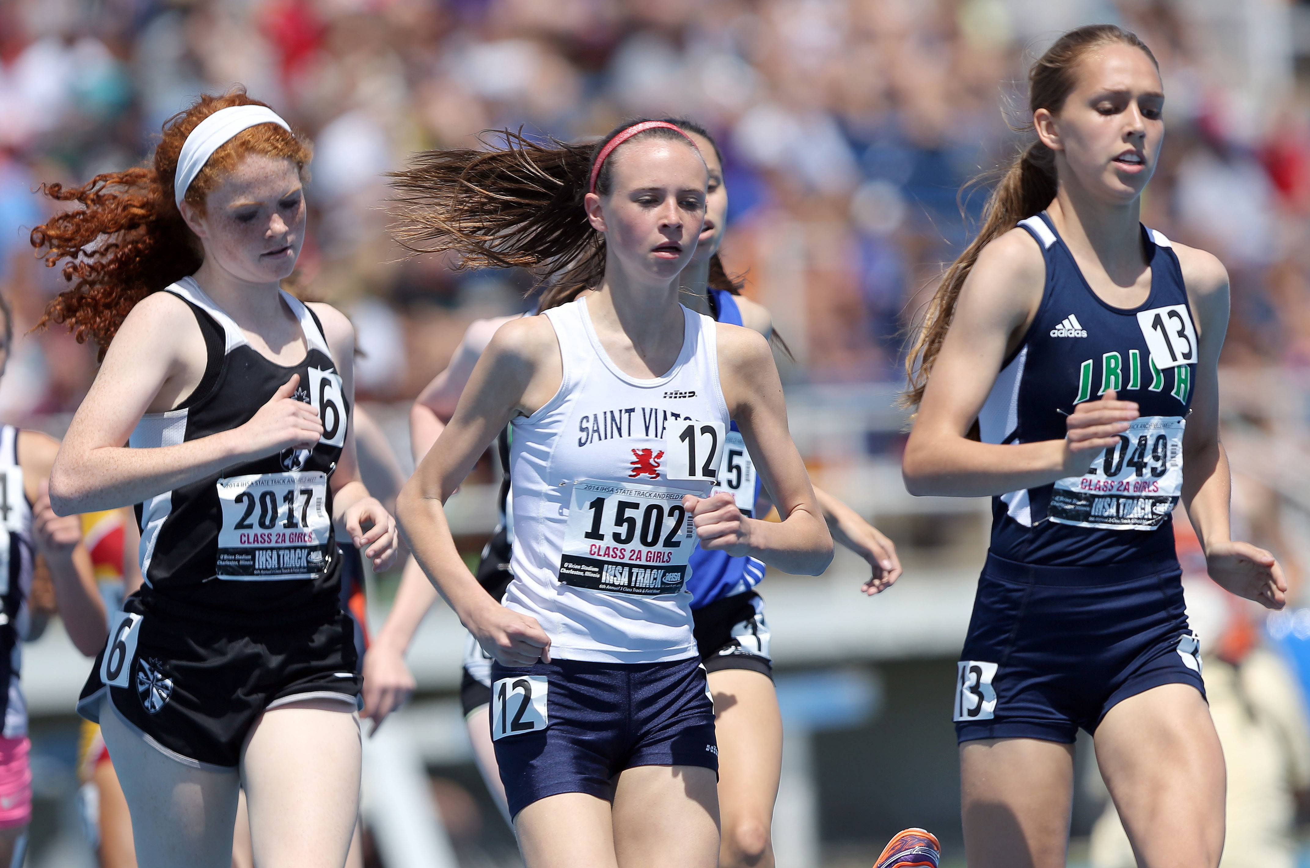 St. Viator's Meghan Carroll, middle, competes in the 1600-meter run during the Class 2A prelims of the girls track and field state meet at Eastern Illinois University in Charleston on Friday.