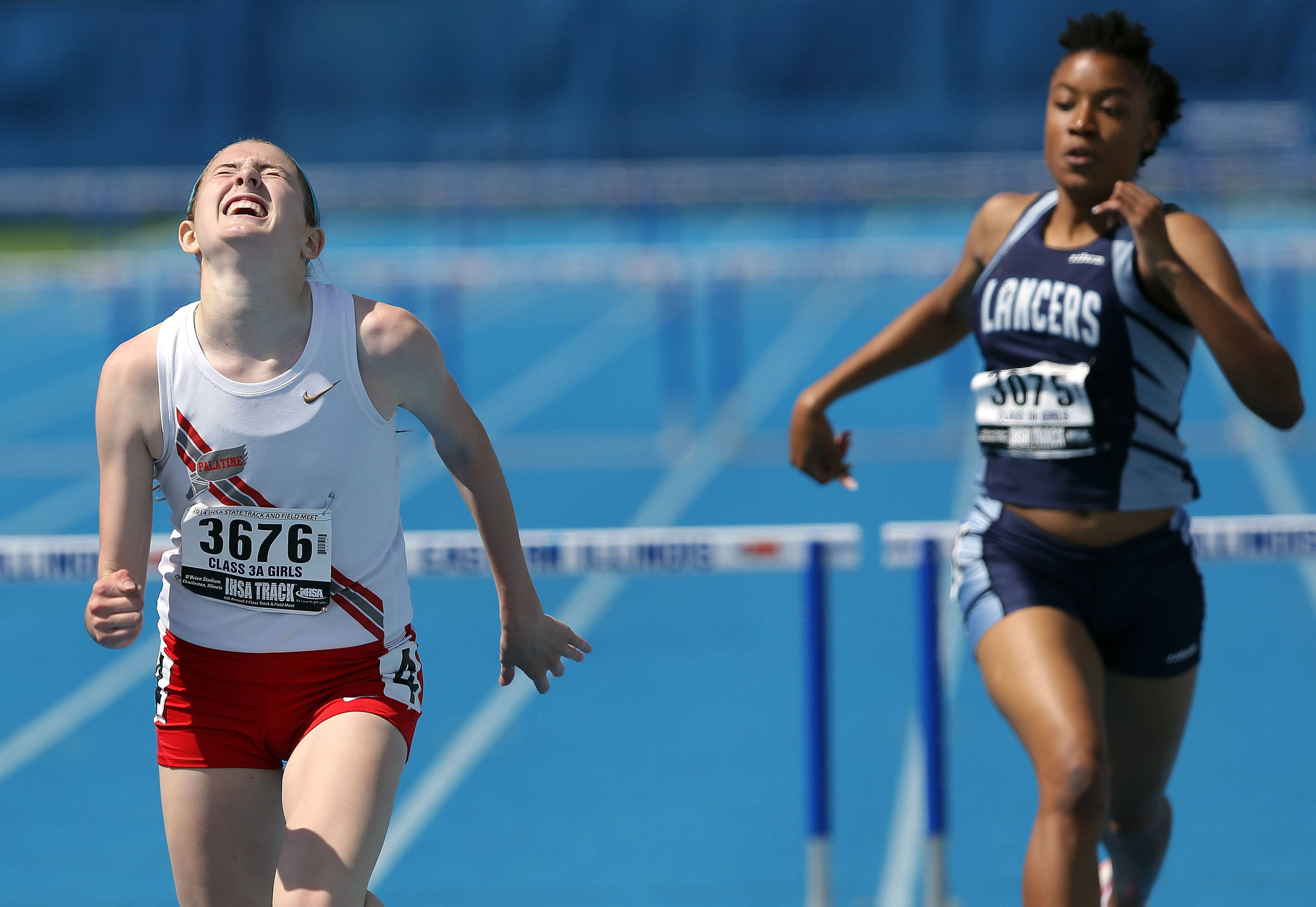 Palatine's Caitlin Riedy pushes to the finish in the 300-meter low hurdles during the Class 3A prelims of the girls track and field state meet at Eastern Illinois University in Charleston on Friday.