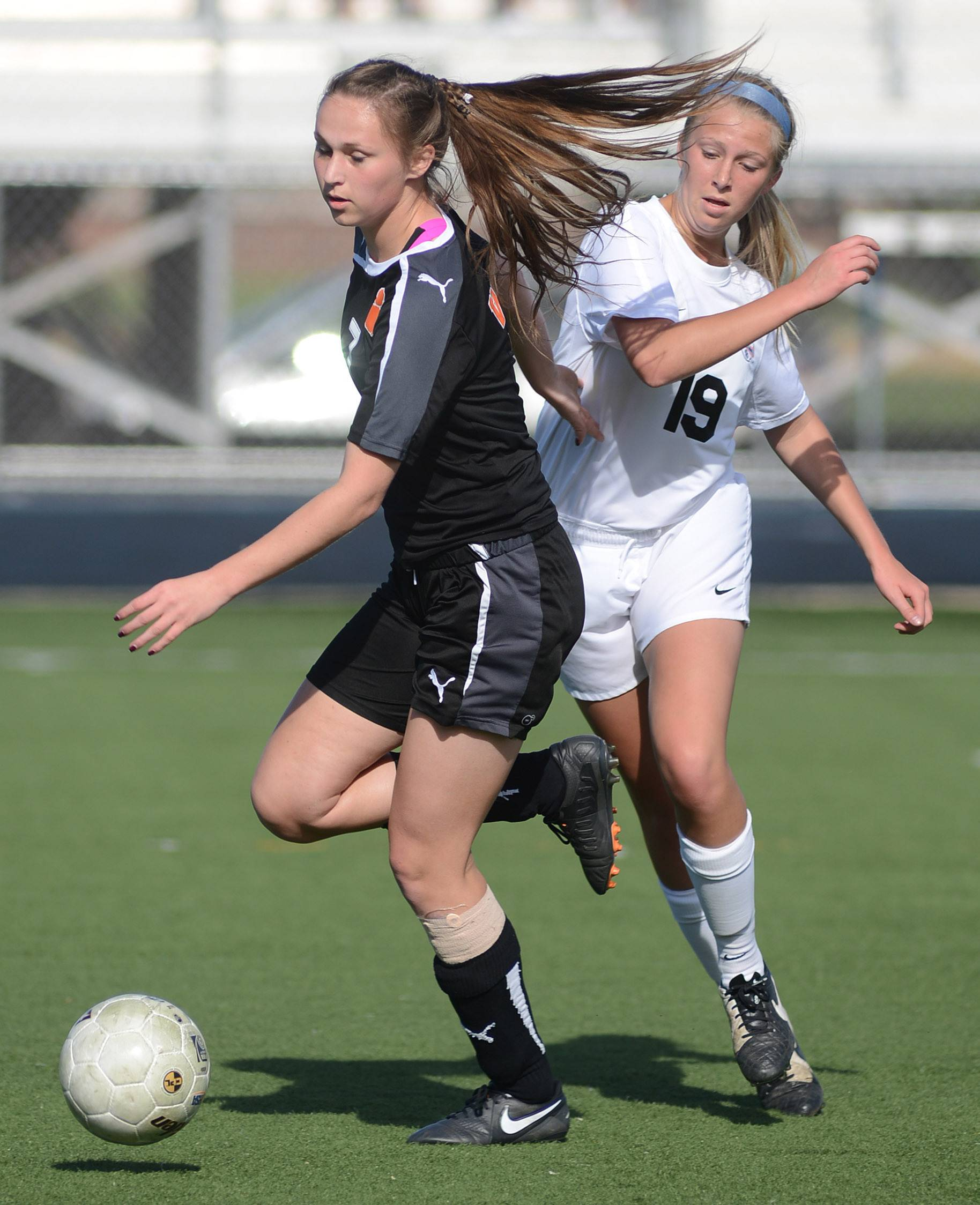 Wheaton Warrenville South's Alexis Jakuszewski and St. Charles East's Sophie Jendrzeczyk battle for the ball in the first half of the regional title game at West Chicago High School on Friday, May 23.