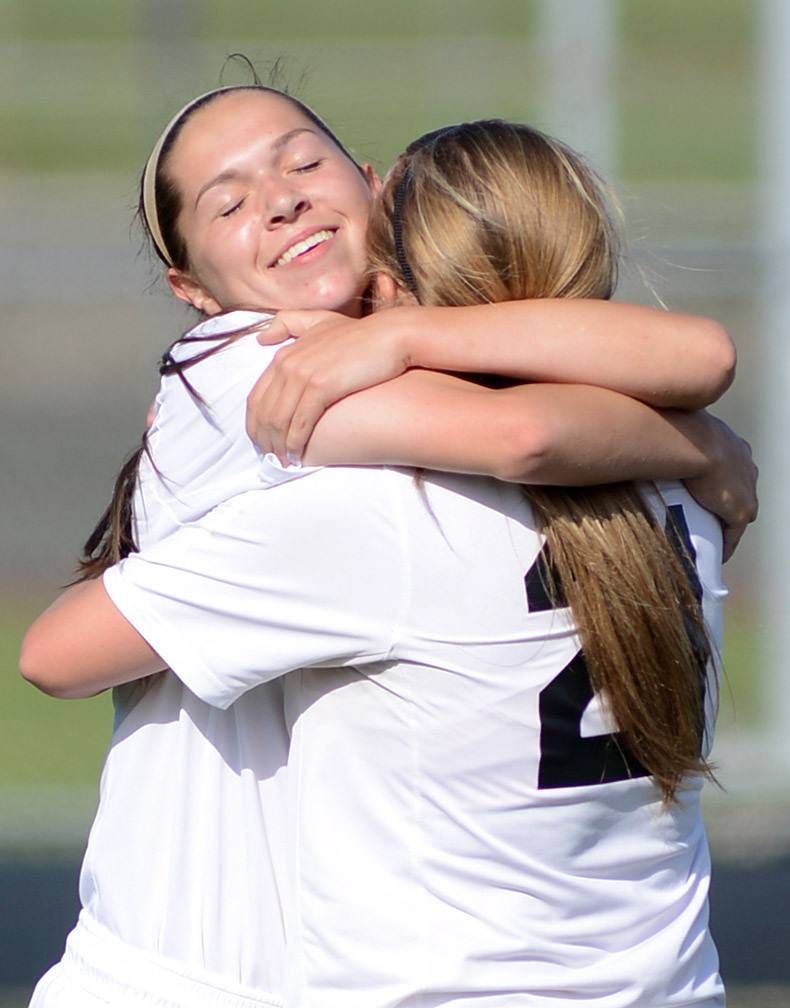 St. Charles East's Darcy Cunningham, left, gets a hug from teammate Amanda Hilton after scoring a goal over Wheaton Warrenville South in the first half of the regional title game at West Chicago High School on Friday, May 23.