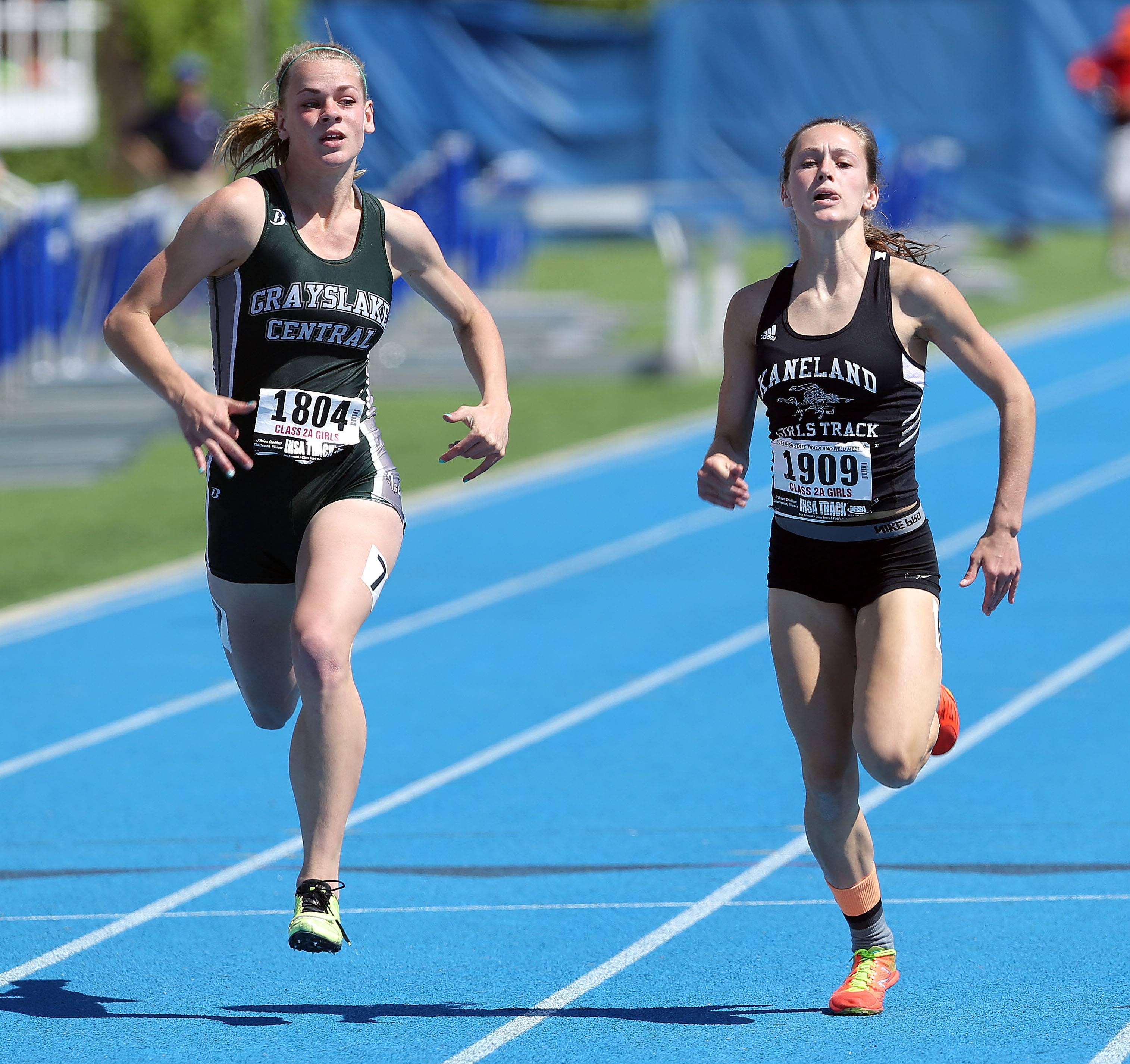 Grayslake Central's Leah Kloss and Kaneland's Nicole Sreenam run in the 100-meter dash during the prelims of the girls track and field state meet at Eastern Illinois University in Charleston Friday.