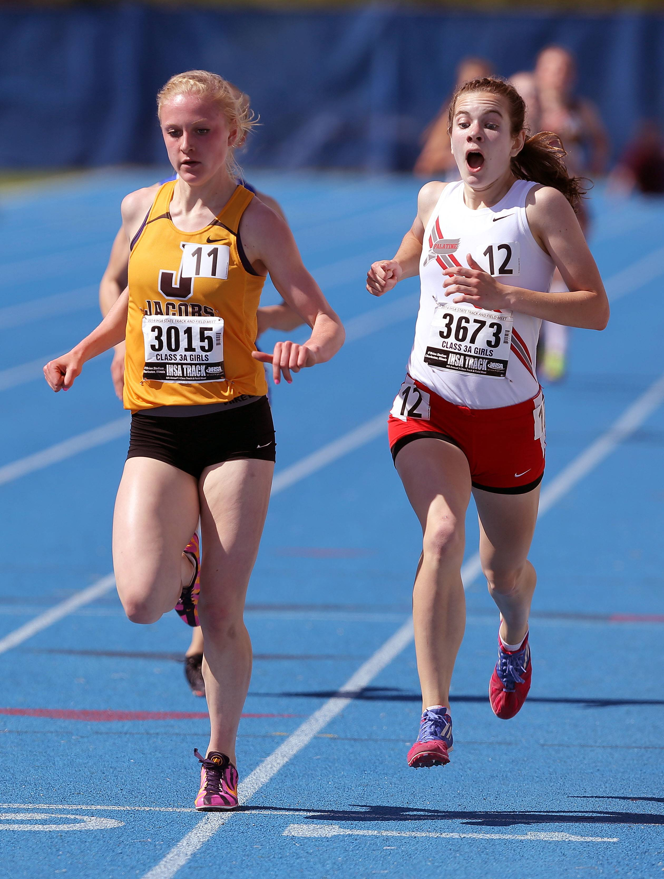 Jacobs' Lauren Van Vlierbergen pushes past Palatine's Kelly O'Brien in the 1600-meter run during the prelims of the girls track and field state meet at Eastern Illinois University in Charleston Friday.