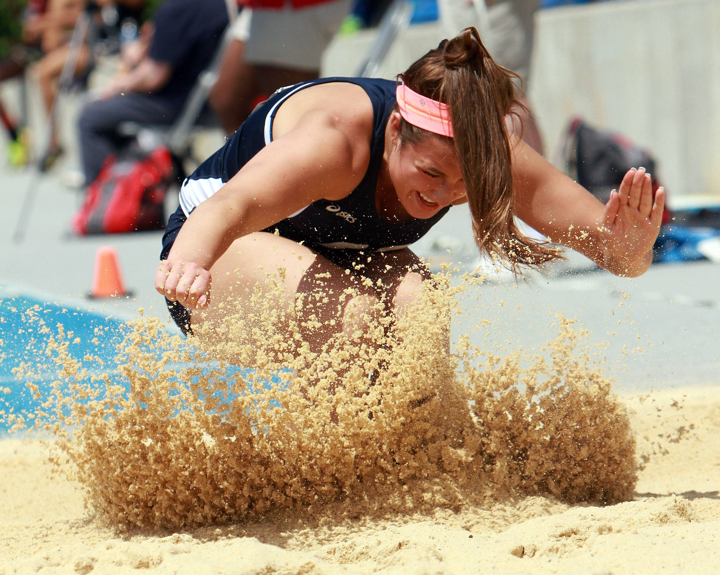 Cary-Grove's Delaney Perrone competes in the triple jump during the 3A prelims of the girls track and field state meet at Eastern Illinois University in Charleston Friday.