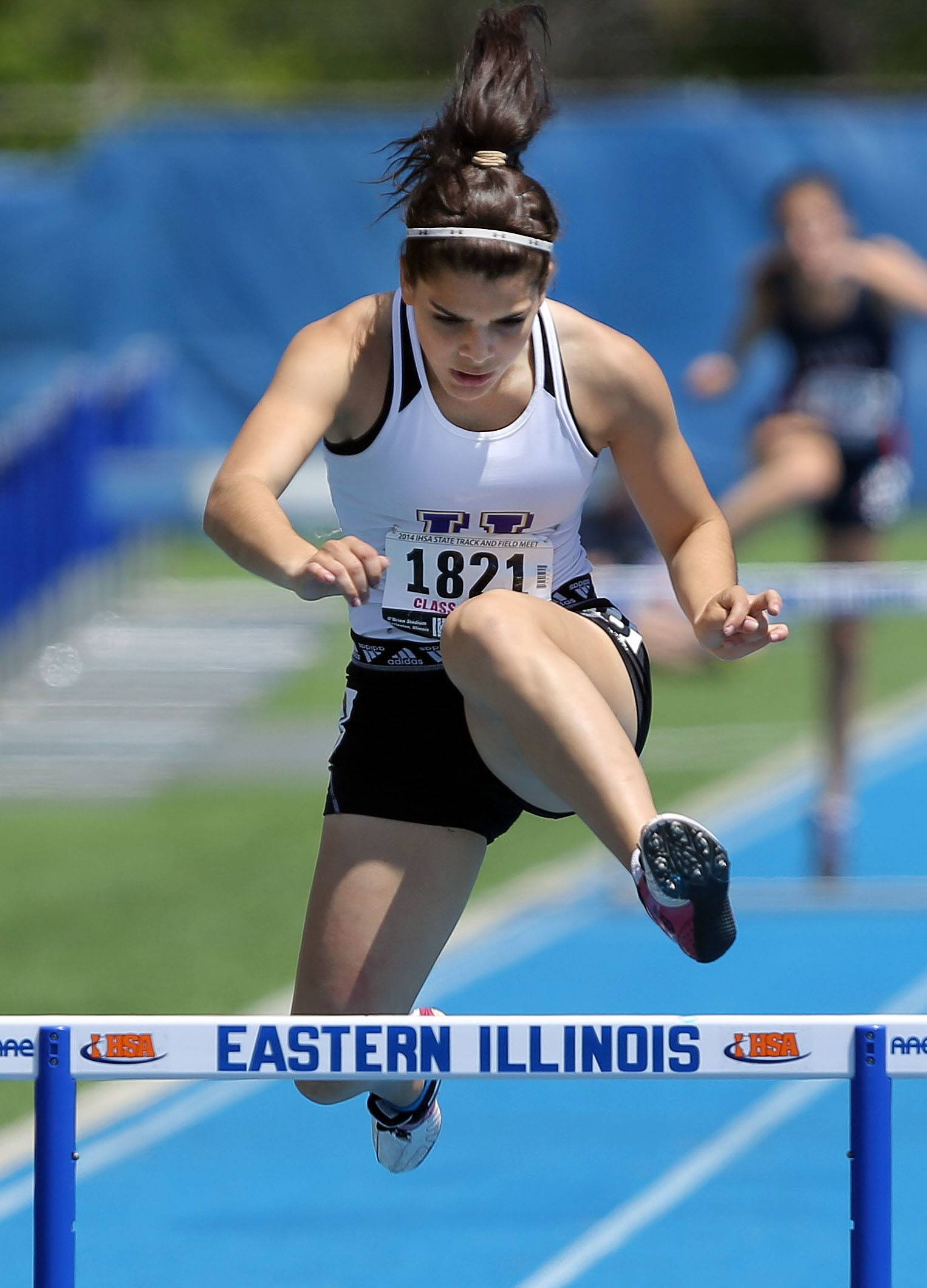 Hampshire's Elizabeth Pagan runs in the 300-meter low hurdles low hurdles during the prelims of the girls track and field state meet at Eastern Illinois University in Charleston Friday.
