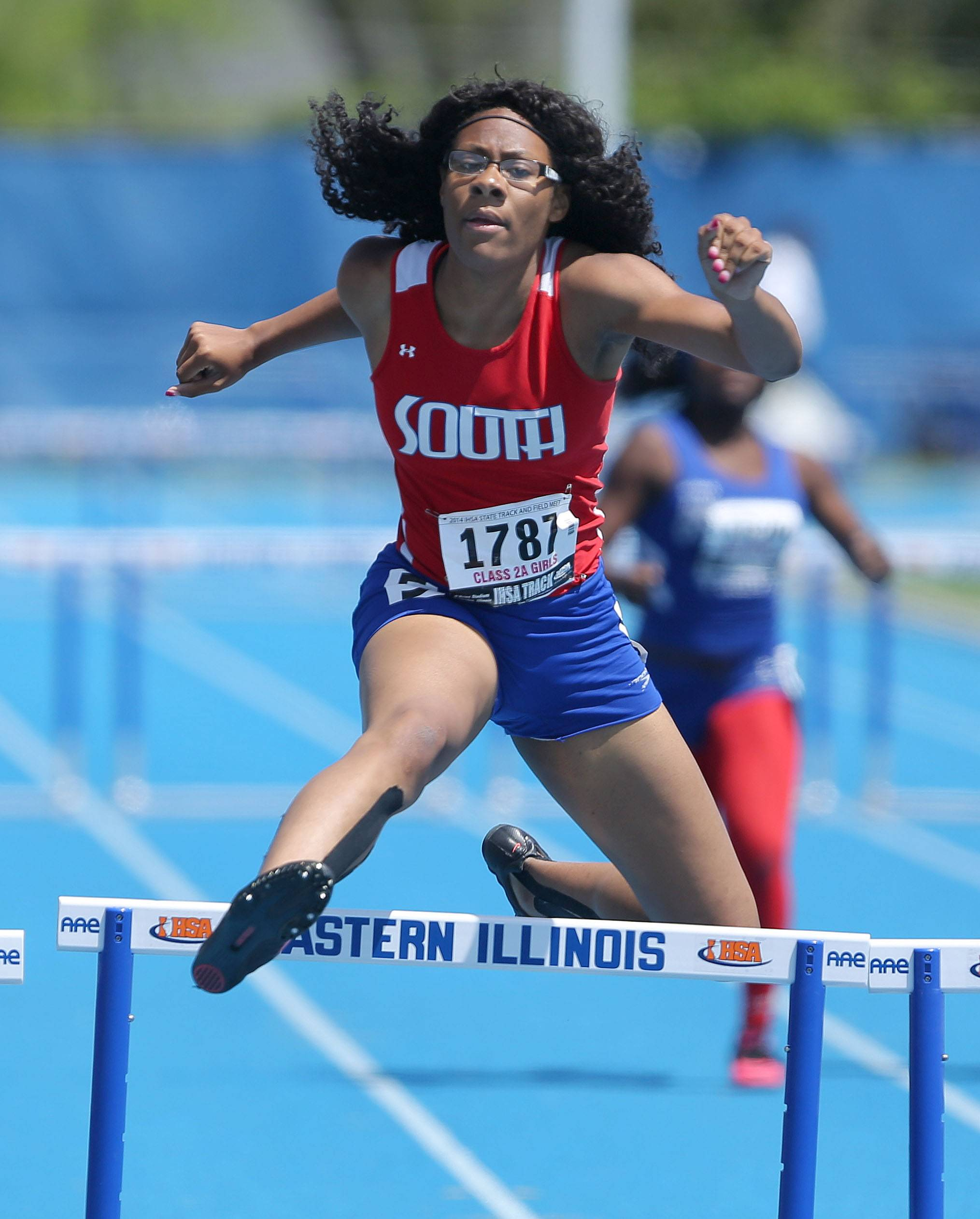 Glenbard South's Katelyn Hill runs in the 300-meter low hurdles in Class 2A.