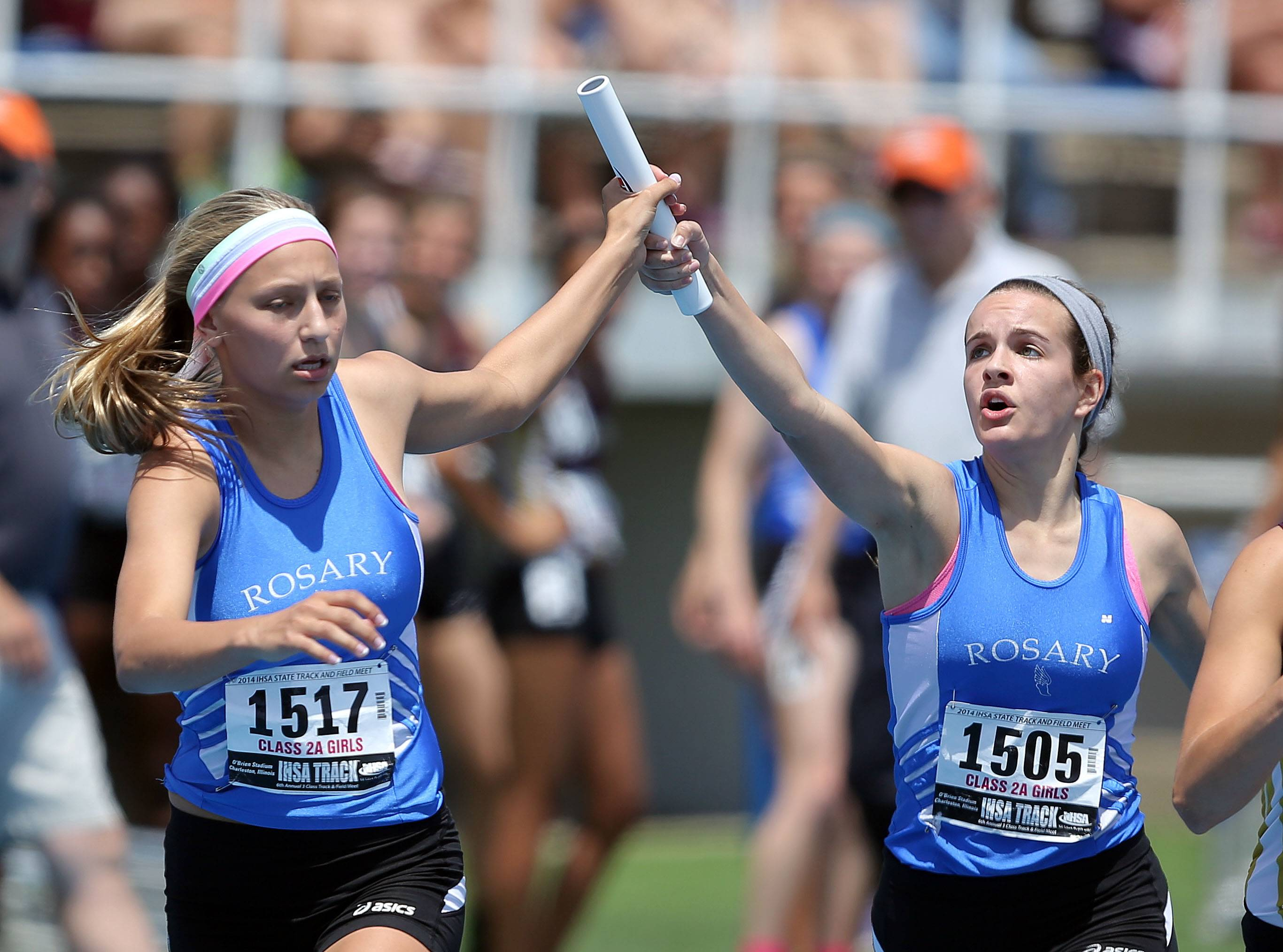 Rosary's Molly Stefanski, left, takes the baton from Emily Bakala in the 4x400-meter relay in Class 2A.