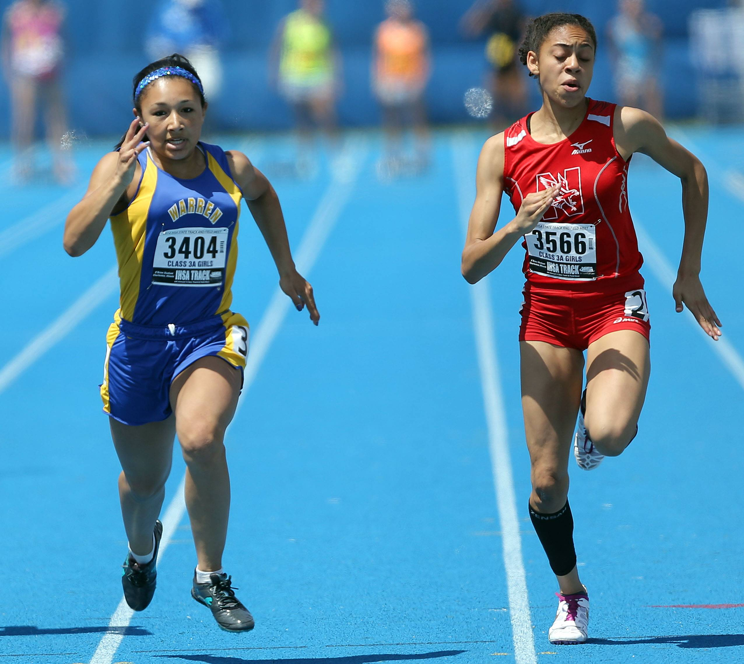 Warren's Autumn Santos and Naperville Central's during the Class 3A prelims.