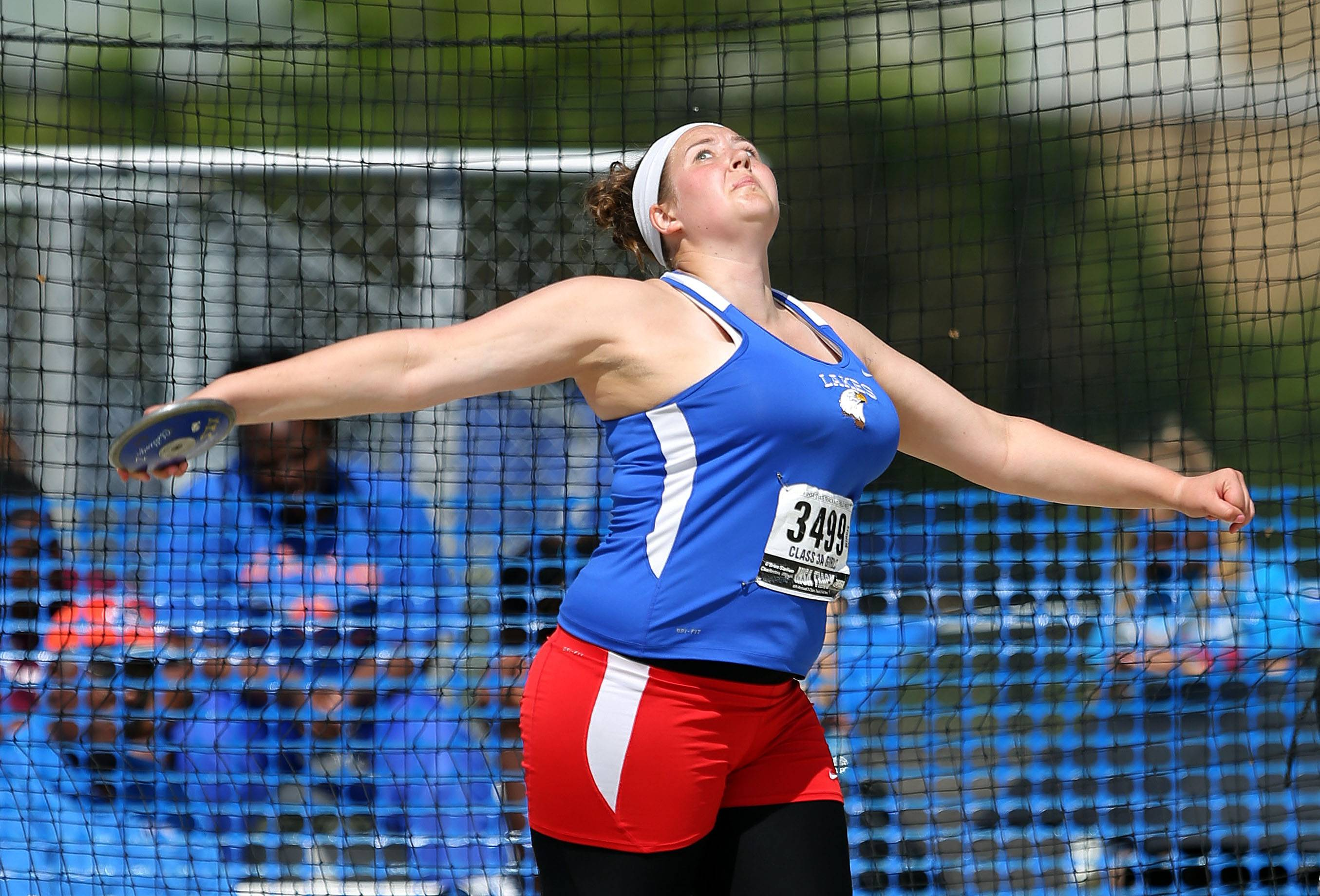 Lakes' Emily Webster competes in the discus during the Class 3A prelims.