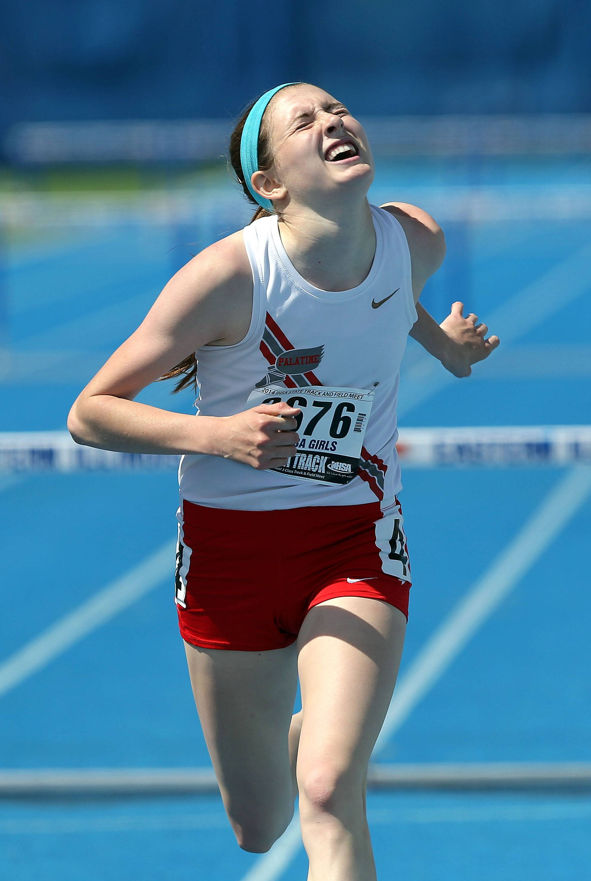 Palatine's Caitlin Riedy pushes to the finish in the 300-meter low hurdles during the Class 3A prelims.