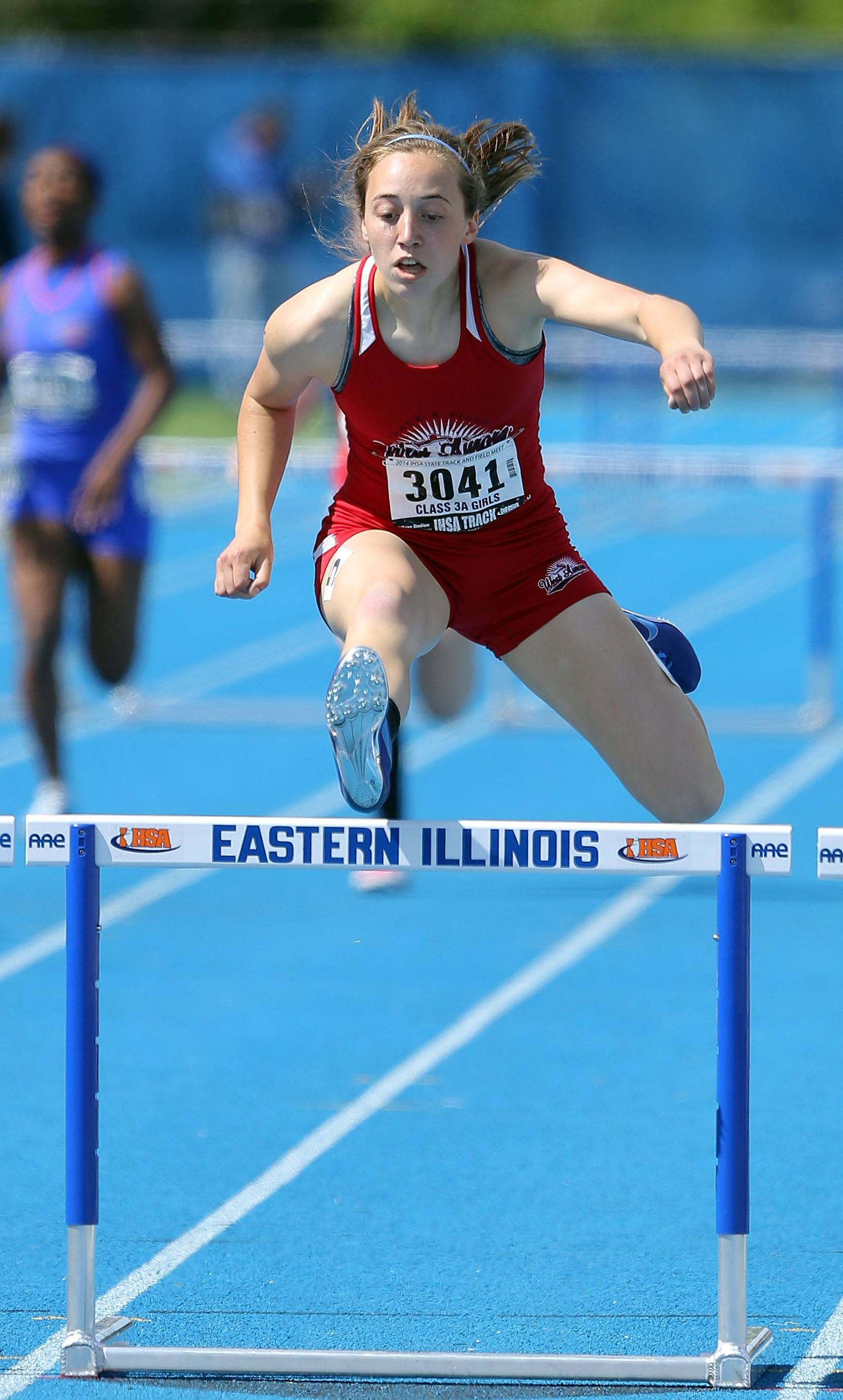 Aurora West's Emma Spagnola competes in the 300-meter low hurdles during the Class 3A prelims.