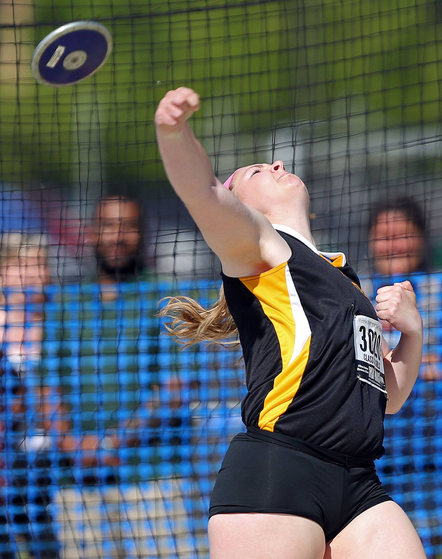 Metea Valley's Holly Julifs competes in the discus during the Class 3A prelims.