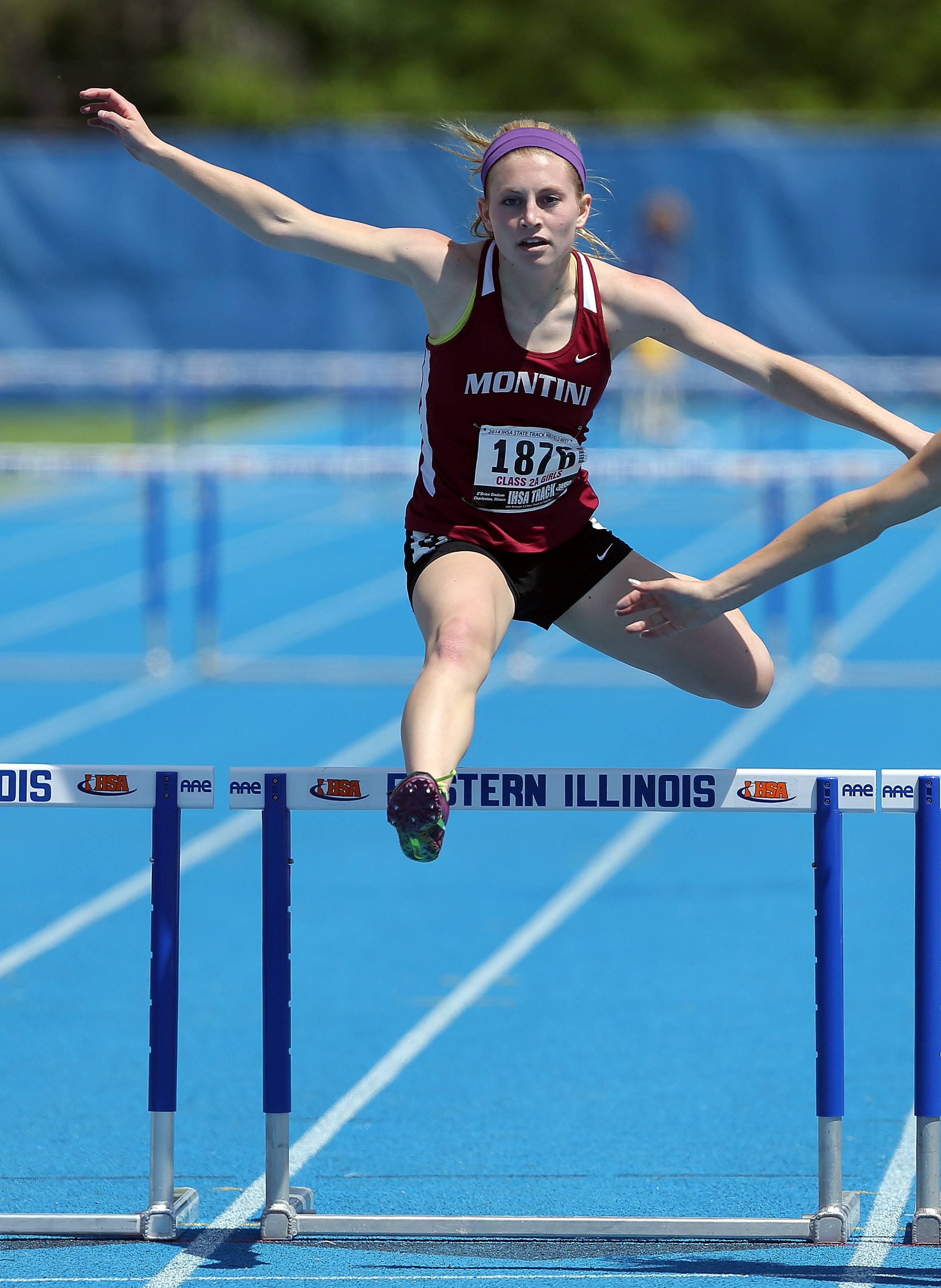 Montini's Gianna Salzbrunn runs in the 300-meter low hurdles in Class 2A.