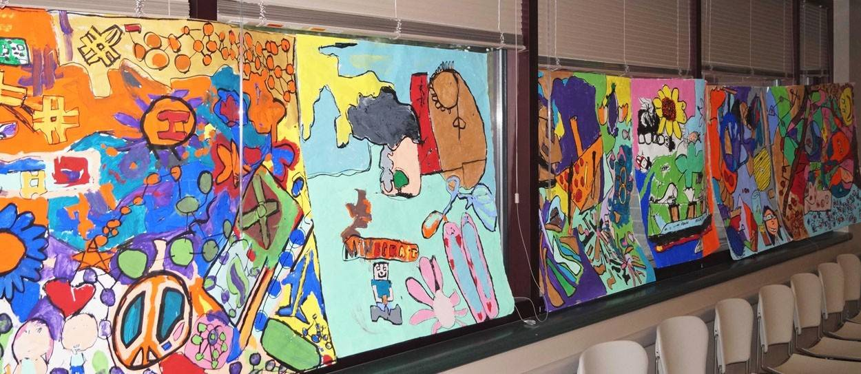 To celebrate Children's Day, Gray M. Sanborn School art teacher Joanna Angelopolos' students created collage-style murals which were displayed at the Palatine Library.