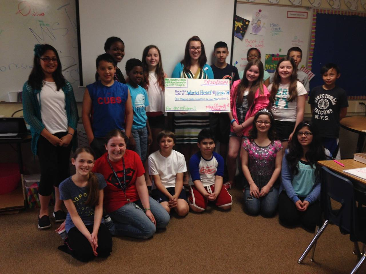 Photo taken at Stevenson School. Mrs. Traub's 5th/6th grade class with World Relief Representative, Maggie.Back row from left: Zara, Ryan, Amina, Isaiah, Kelsey, Maggie of World Relief-Wheaton, Jorge, Genesis, Garrett2nd row standing on the right: Aliya, Natalie, MarkusBottom row from left: Lily, Mrs. Jennifer Traub, Carson, Edwin, Julia, Jacky(Missing: Nithila, Shariq, Giovanni, A.J., Erica)Yasmina Blackburn