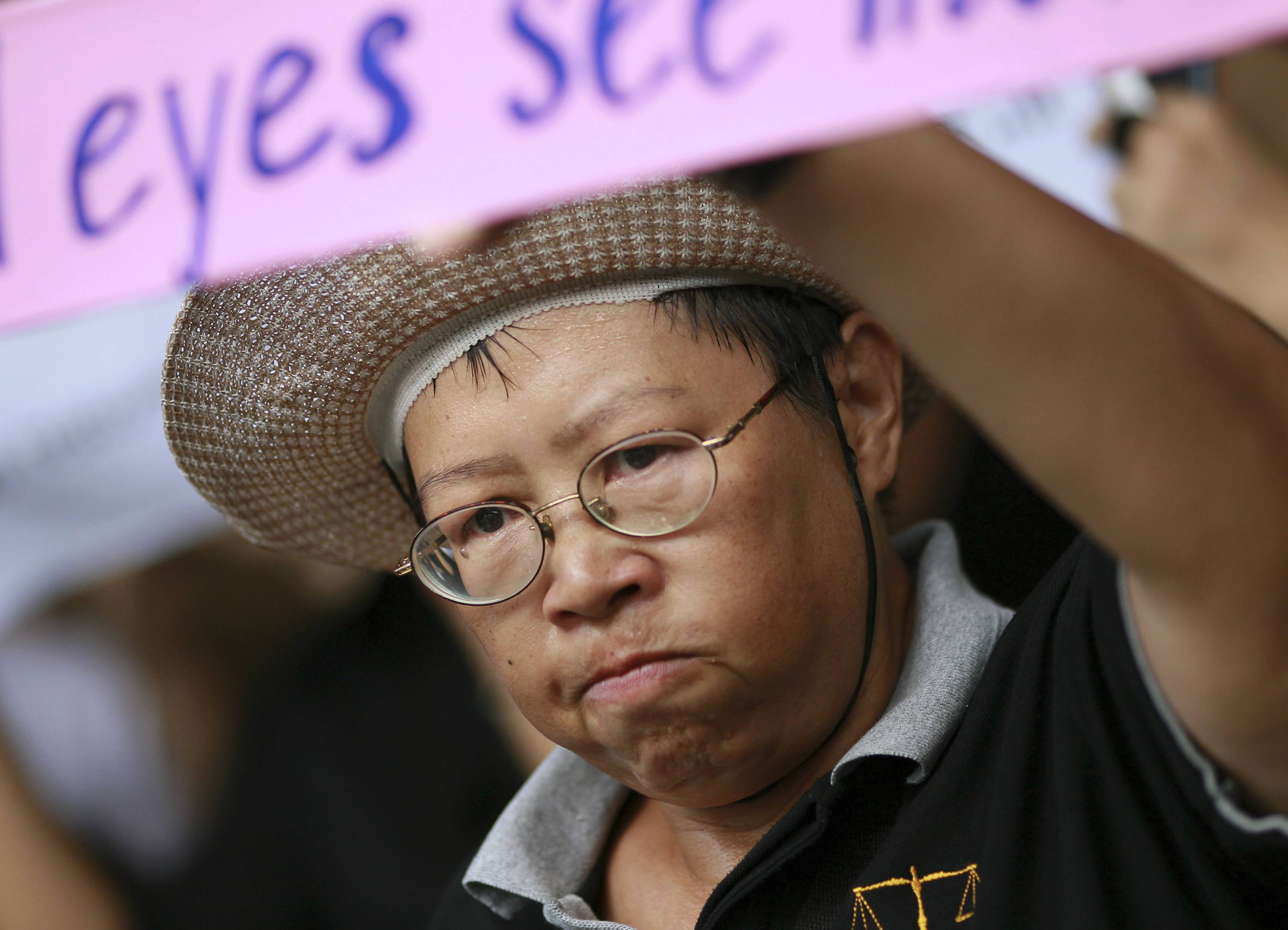 A Thai woman joins a protest Saturday against the coup outside a shopping complex in Bangkok, Thailand.