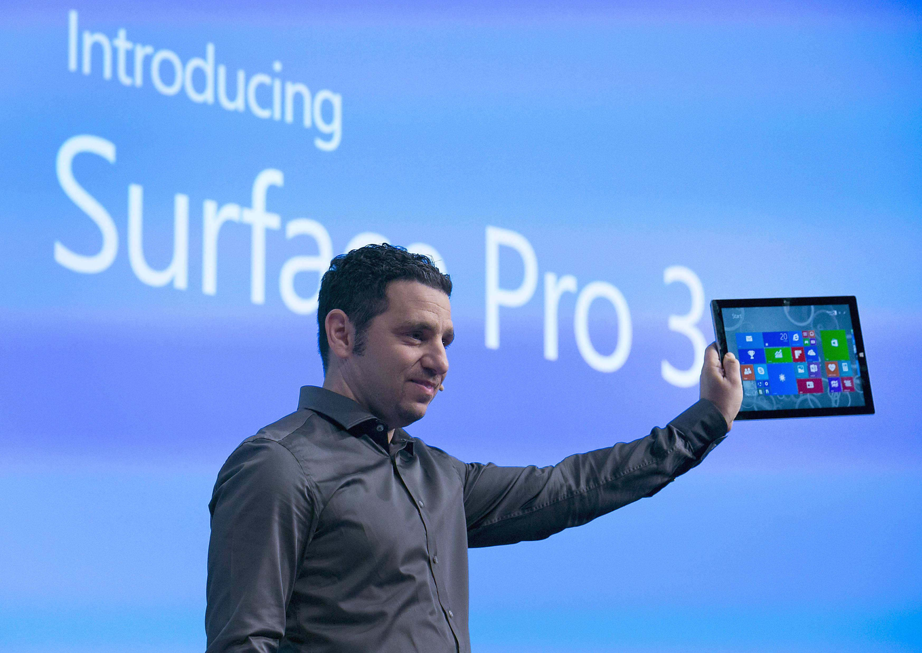 Panos Panay, corporate vice president of Microsoft Corp. Surface, displays the Surface Pro 3 during an event in New York. Microsoft Corp. introduced a larger-screen Surface tablet that is thinner and faster than the previous Surface Pro model, its latest attempt to gain share in the market dominated by Google Inc. and Apple Inc.