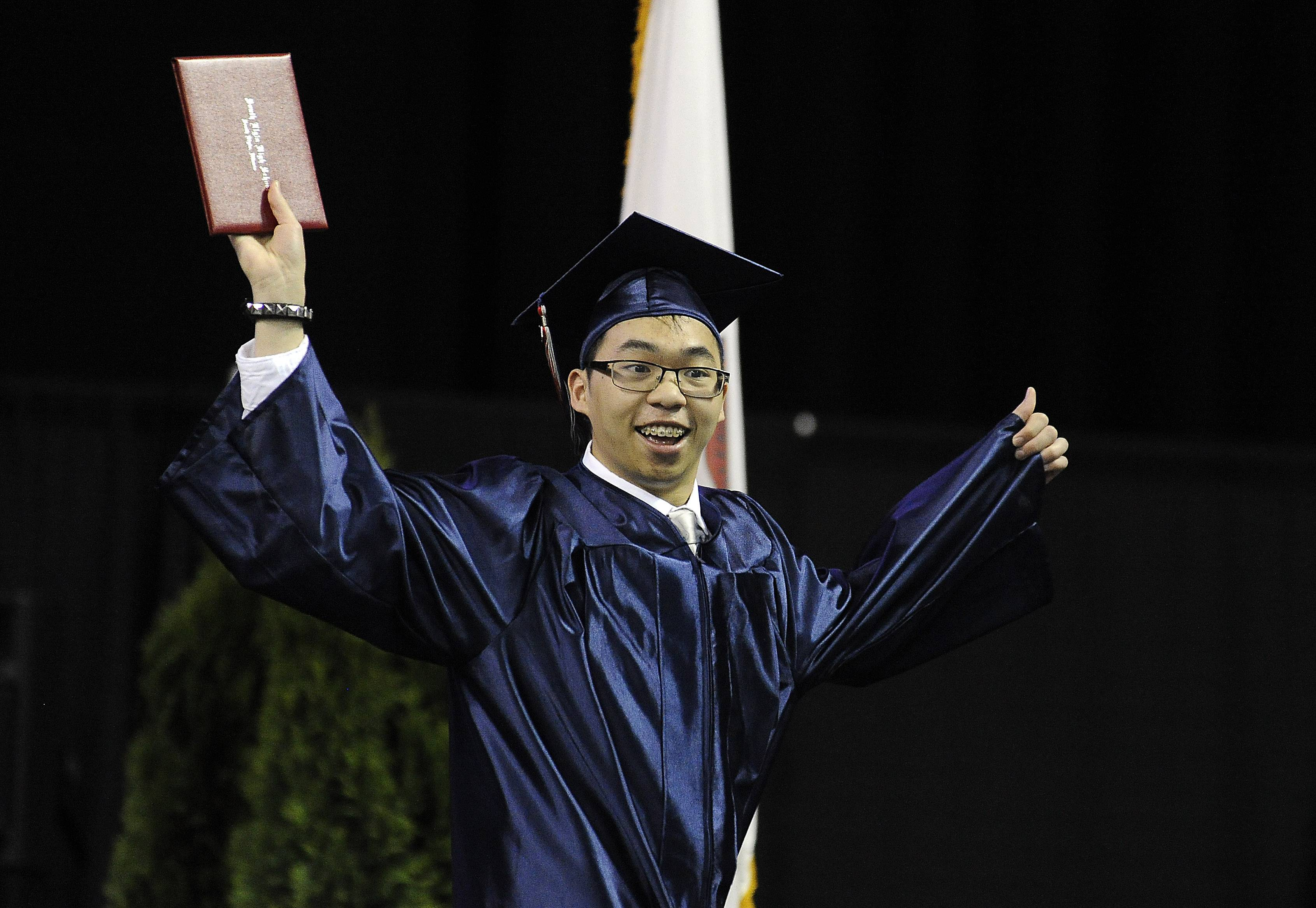 Jay Kettavong, 18, of Elgin starts to feel the excitement of being a graduate of South Elgin High School as the commencement exercises come to a close at the Sears Centre in Hoffman Estates on Saturday.