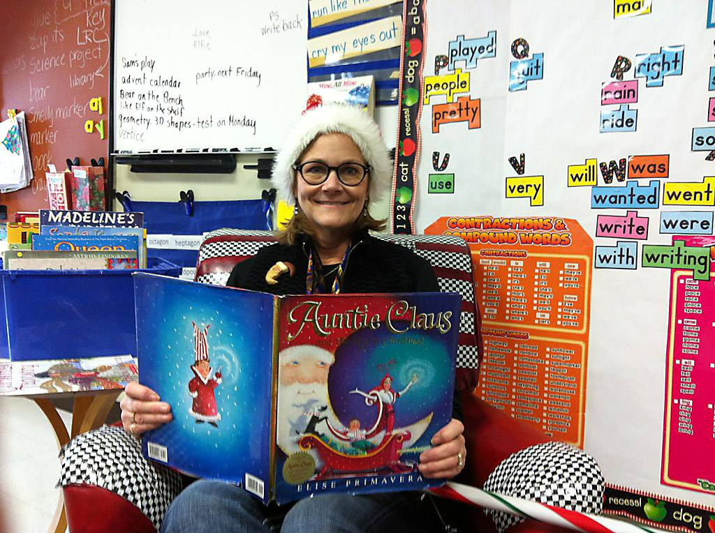 "Retiring H.C. Storm Elementary School teacher Kathy Hubbard in her lounge chair, ""Big Red,"" during the holiday season."