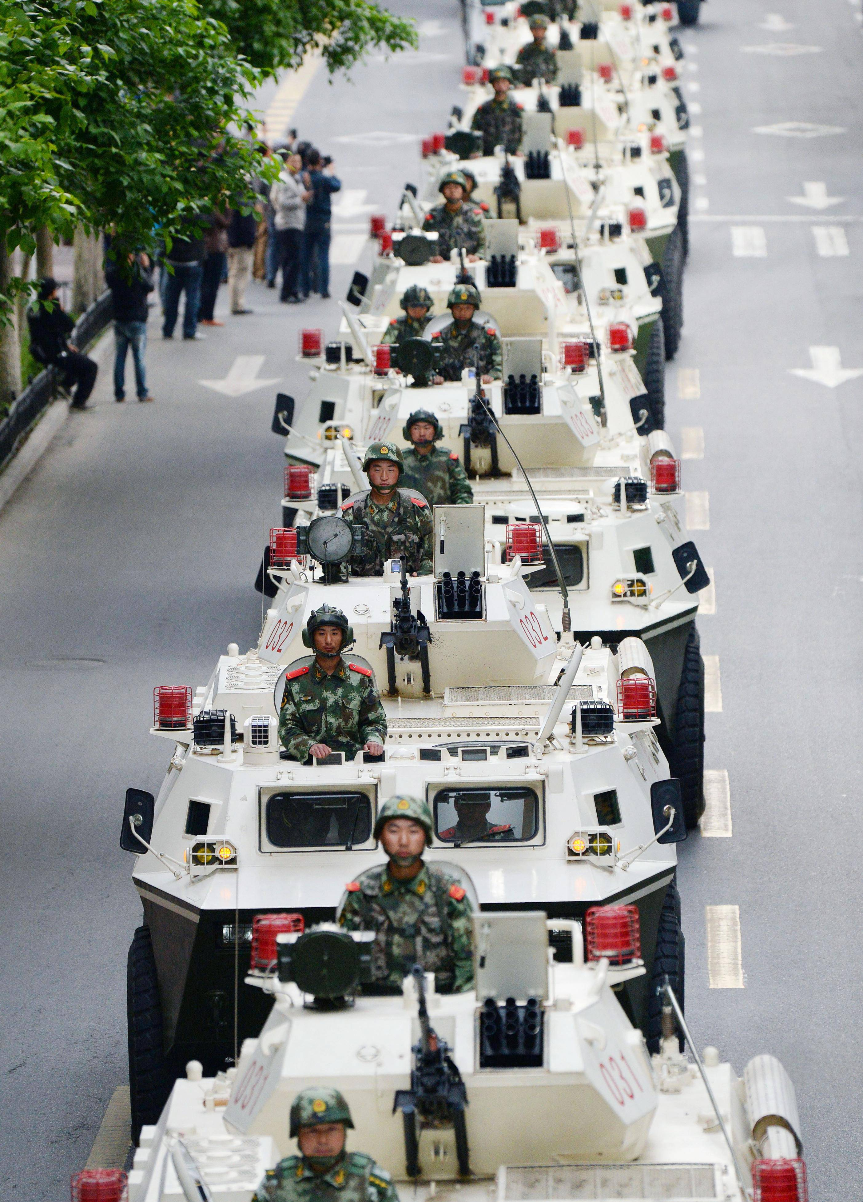 On Friday, May 23, paramilitary policemen on their armored vehicles parade on a street in Urumqi, China's northwestern region of Xinjiang. Authorities on Saturday, May 24, announced the first arrest in a bombing in China's Muslim northwest and said they were launching a yearlong anti-terrorism crackdown.