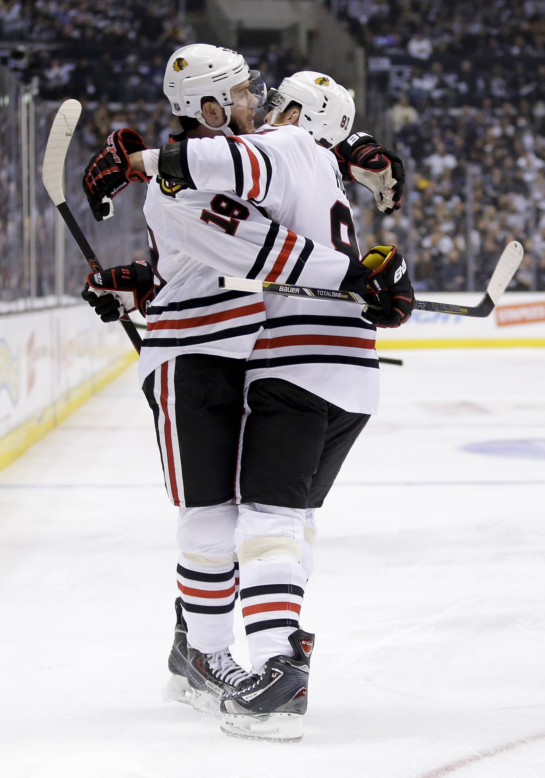Chicago Blackhawks center Jonathan Toews, left, celebrates his goal against the Los Angeles Kings with right wing Marian Hossa during the first period of Game 3 of the Western Conference finals of the NHL hockey Stanley Cup playoffs in Los Angeles, Saturday, May 24, 2014.