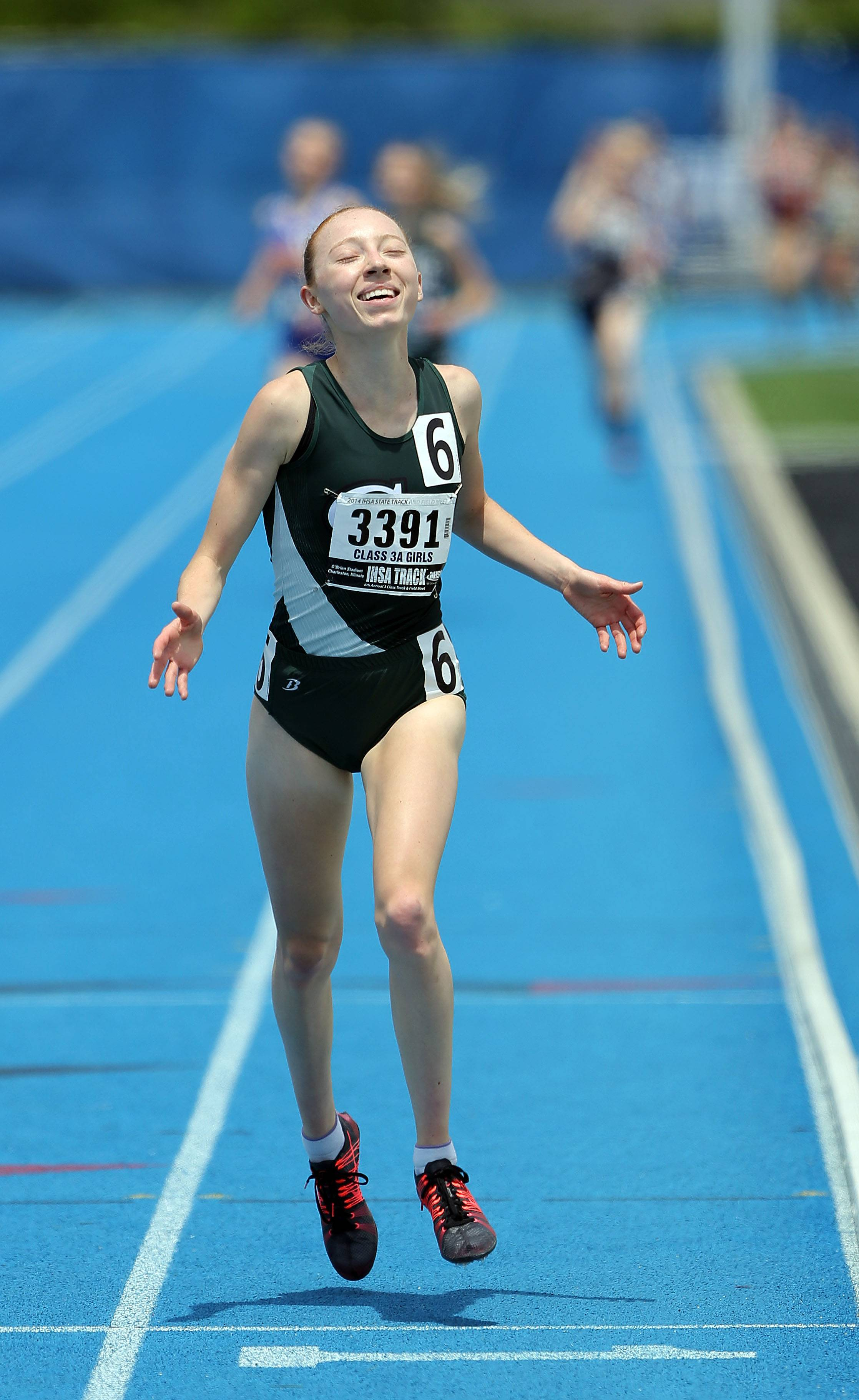 Glenbard West's Madeline Perez wins the Class 3A 3,200-meter run during the girls track and field state finals at Eastern Illinois University in Charleston Saturday.