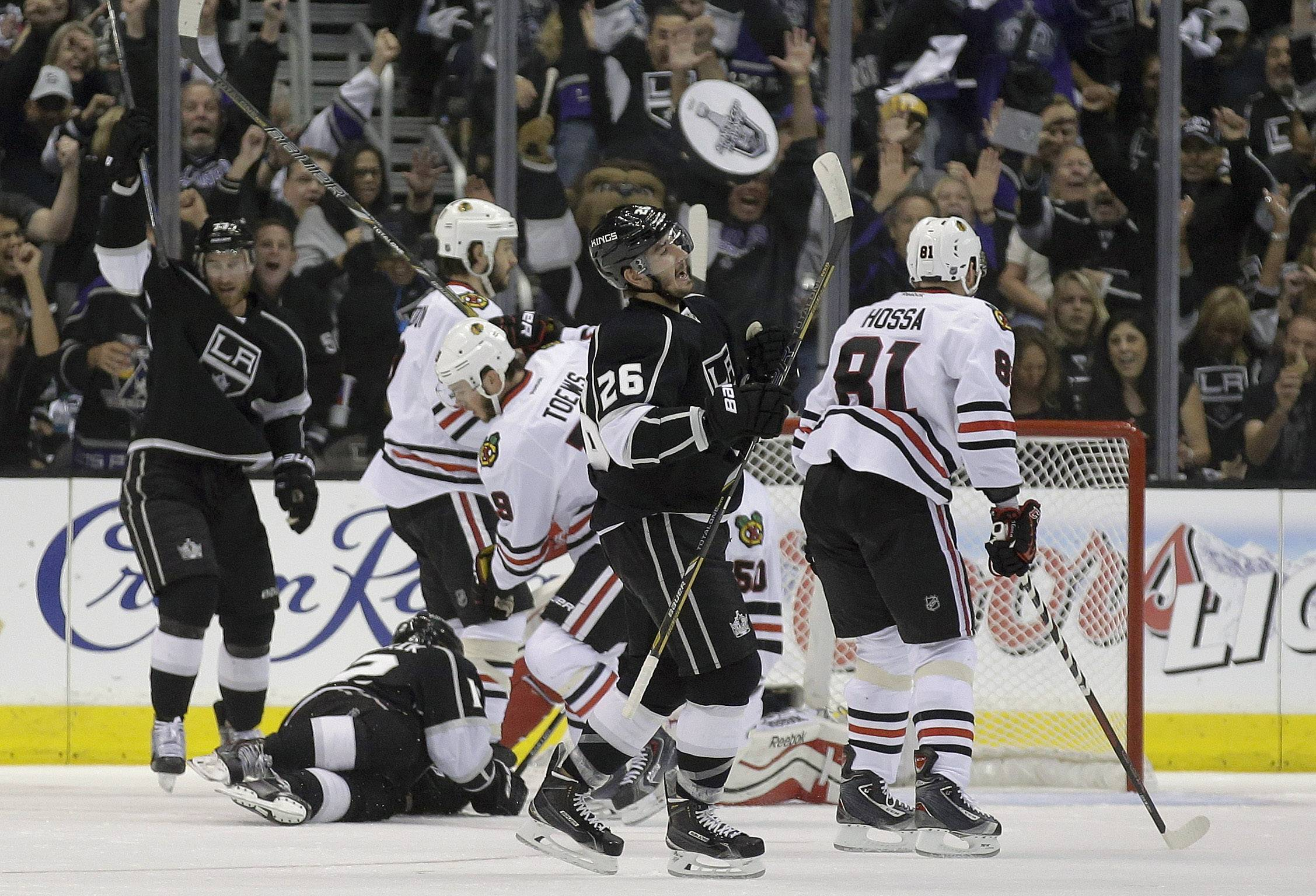 Los Angeles Kings defenseman Slava Voynov (26) celebrates his goal against the Chicago Blackhawks during the first period of Game 3 of the Western Conference finals of the NHL hockey Stanley Cup playoffs in Los Angeles, Saturday, May 24, 2014.