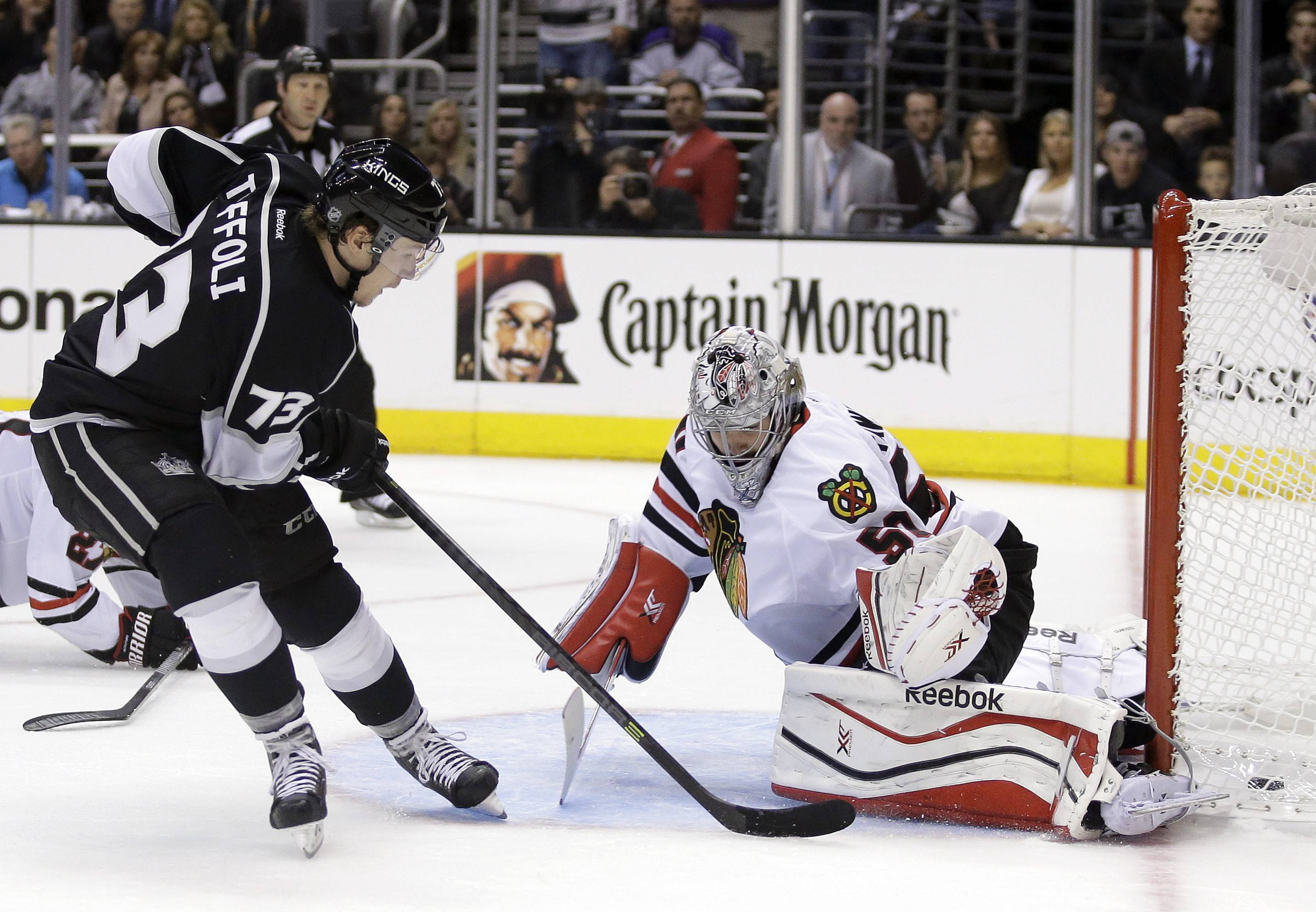 Los Angeles Kings center Tyler Toffoli, left, scores past Chicago Blackhawks goalie Corey Crawford during the second period of Game 3 of the Western Conference finals of the NHL hockey Stanley Cup playoffs in Los Angeles, Saturday, May 24, 2014.