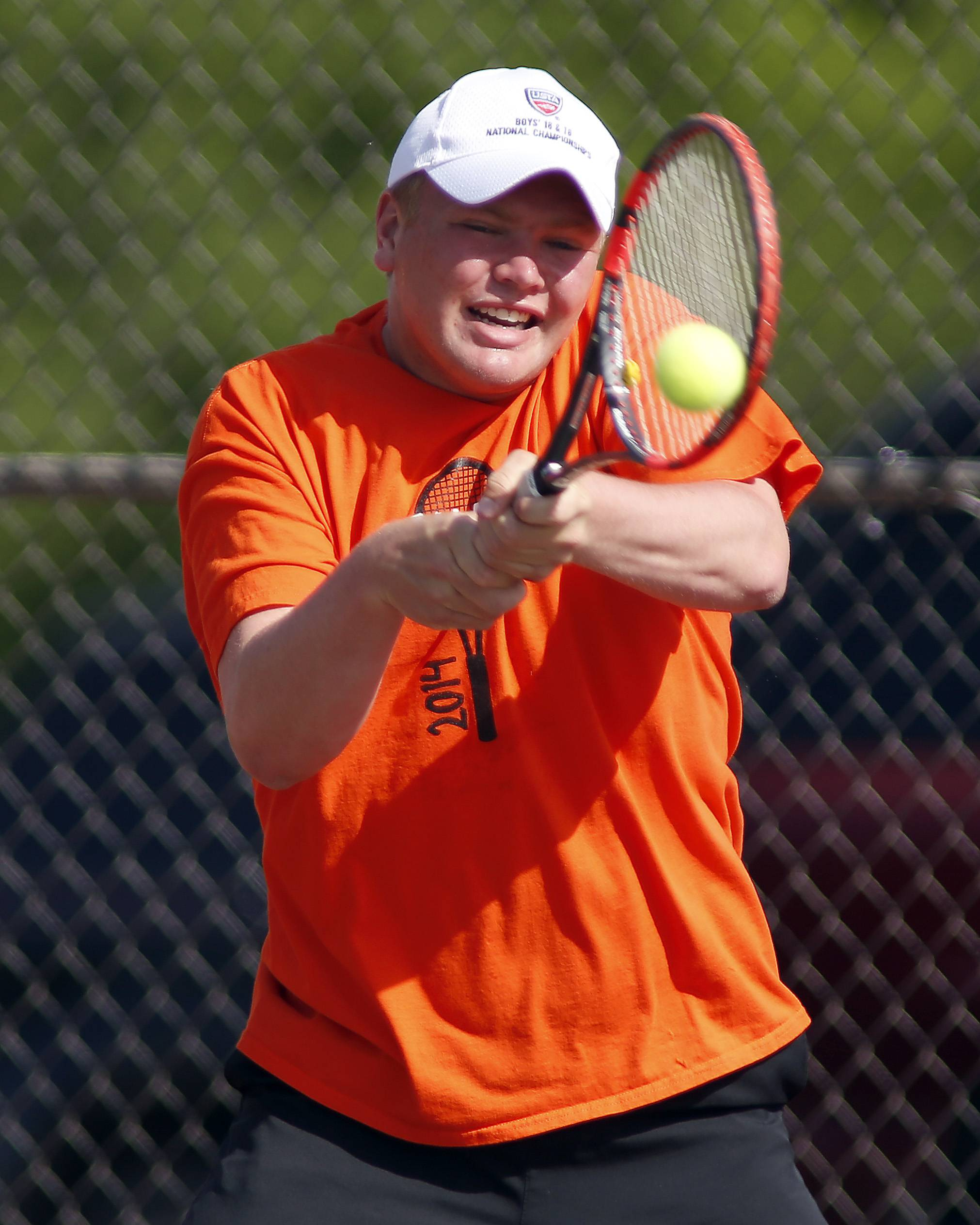 St. Charles East's Jasper Koenen returns a shot from Wheaton Academy's Chris Jones during the St. Charles East boys tennis sectional Saturday in St. Charles.