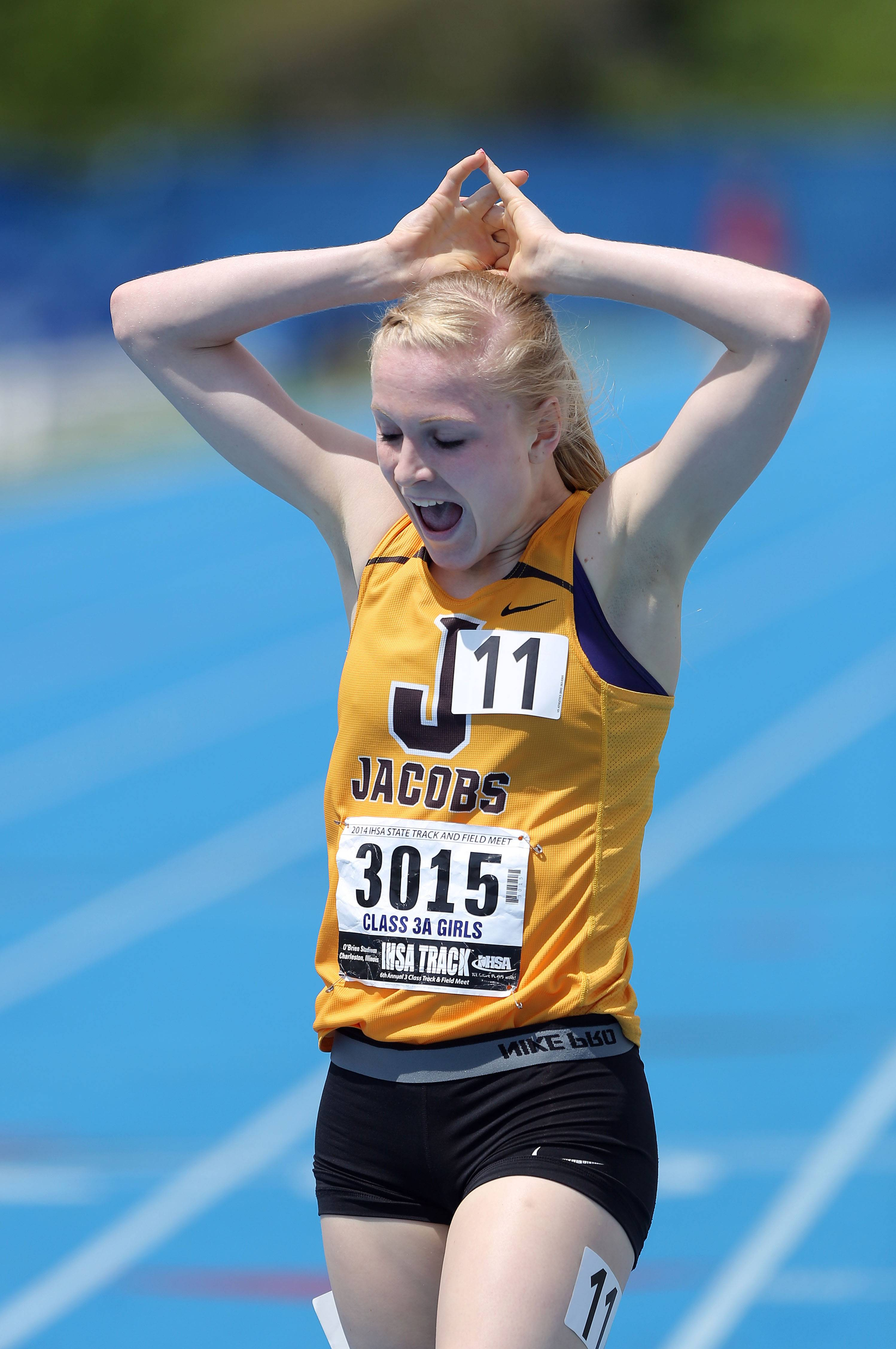 Jacobs' Lauren Van Vlierbergen reacts after winning the Class 3A 800-meter run during the girls track and field state finals at Eastern Illinois University in Charleston Saturday.