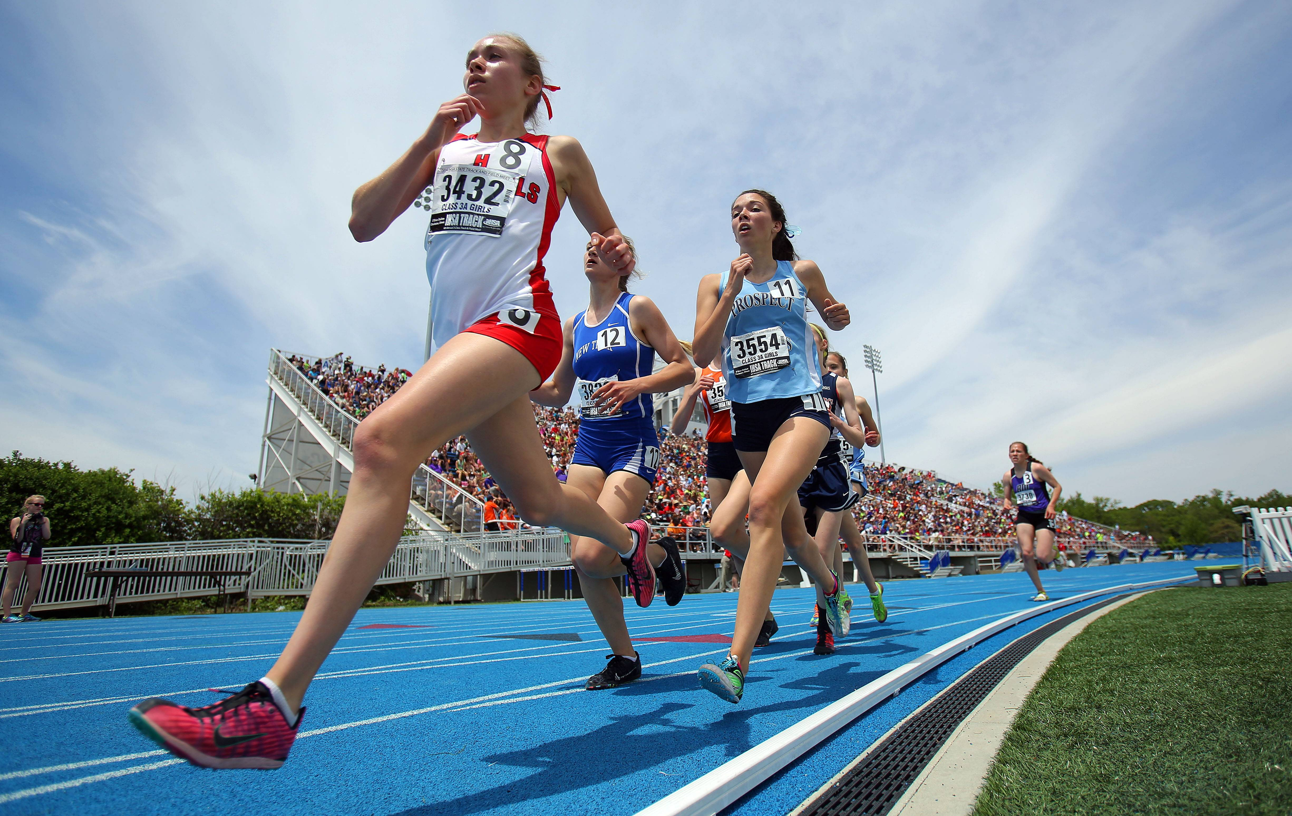 Girls compete in the class 3A 3200-meter run during the girls track and field state finals at Eastern Illinois University in Charleston Saturday.