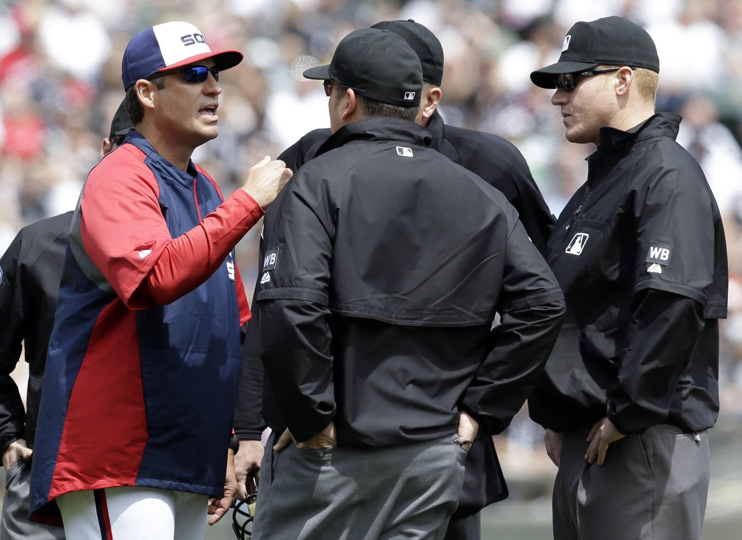 Chicago White Sox manager Robin Ventura, left, argues with umpires during the second inning of a baseball game against the New York Yankees in Chicago on Saturday, May 24, 2014. (AP Photo/Nam Y. Huh)