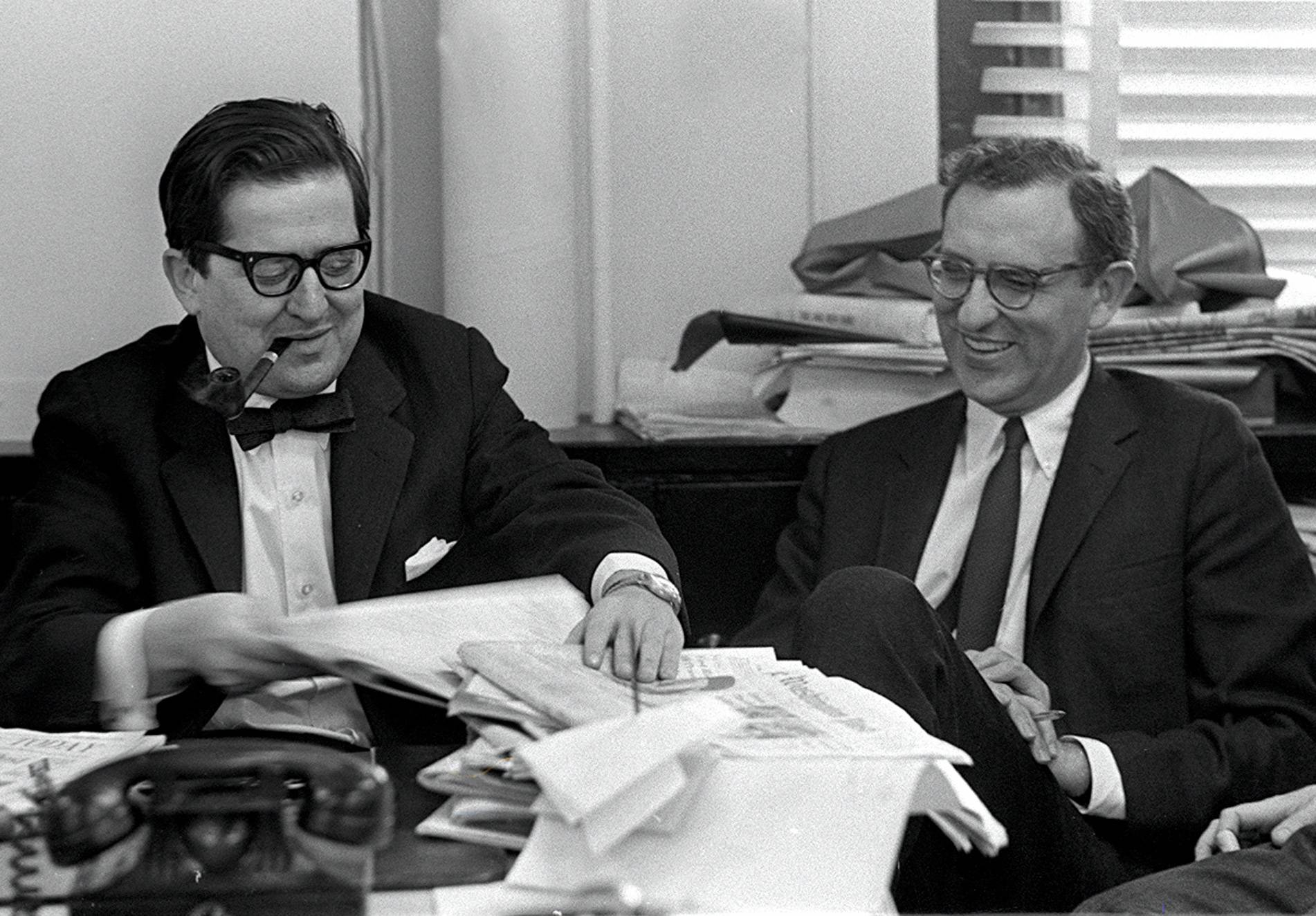 New York Time's editors A.M. Rosenthal, left and Arthur Gelb, are seated at a desk in Rosenthal's office.