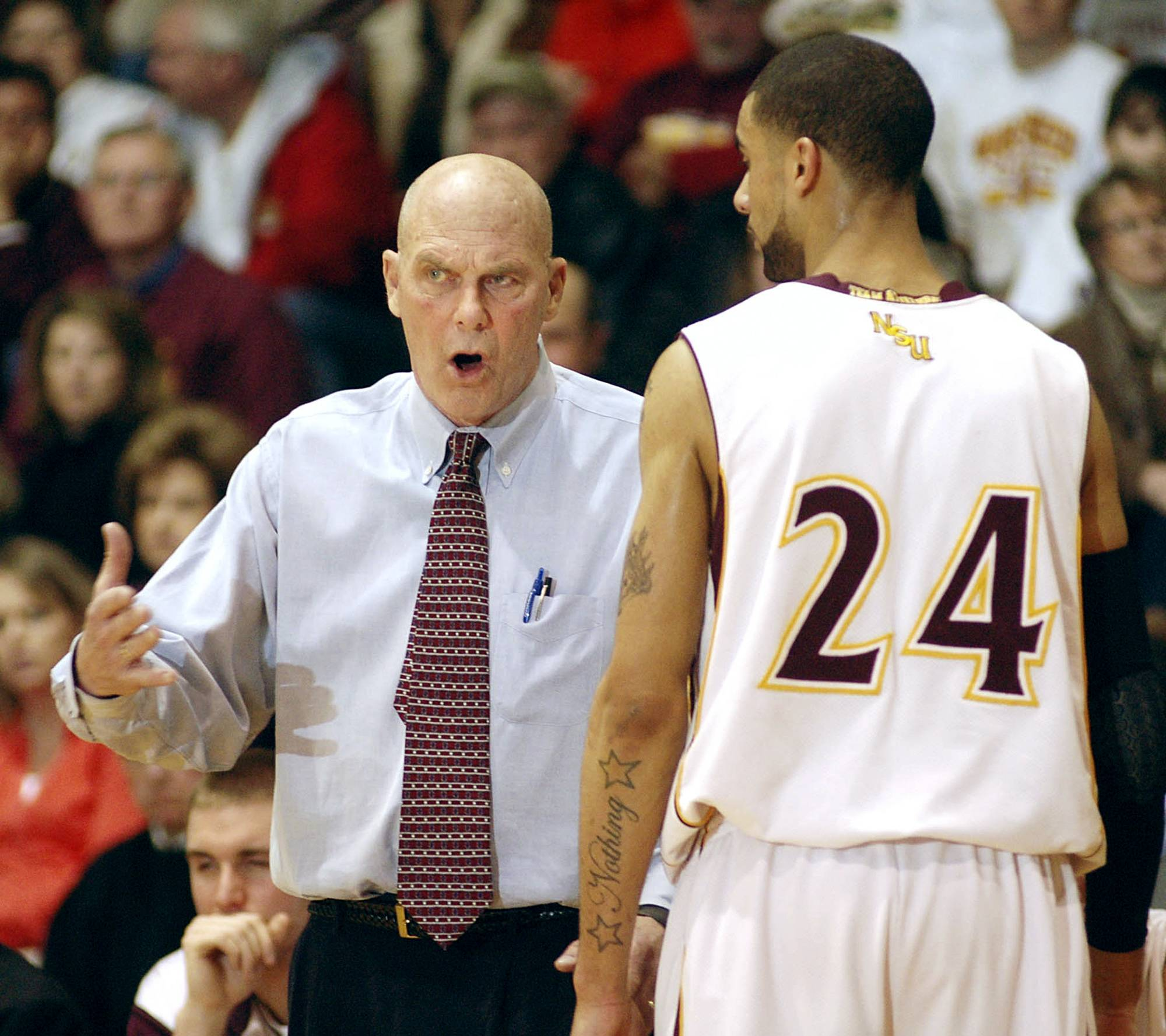 Northern State basketball coach Don Meyer talks with Northern forward Colin Pryor.
