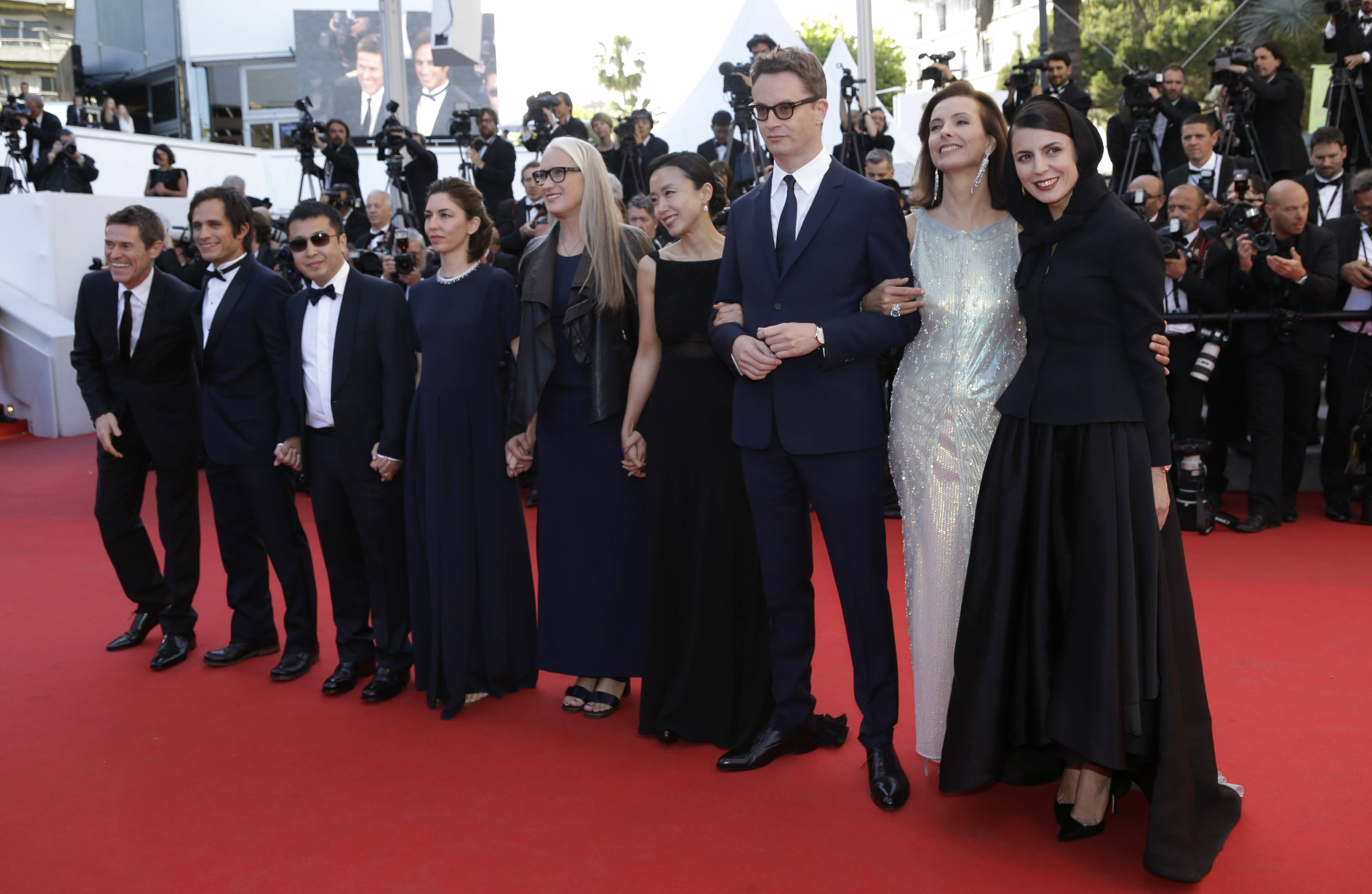 From left, jury members, Willem Dafoe, Gael Garcia Bernal, Jia Zhangke, Sofia Coppola, president of the jury Jane Campion, Jeon Do-yeon, Nicolas Winding Refn, Carole Bouquet and Leila Hatami arrive Saturday for the awards ceremony at the 67th international film festival, Cannes, southern France.