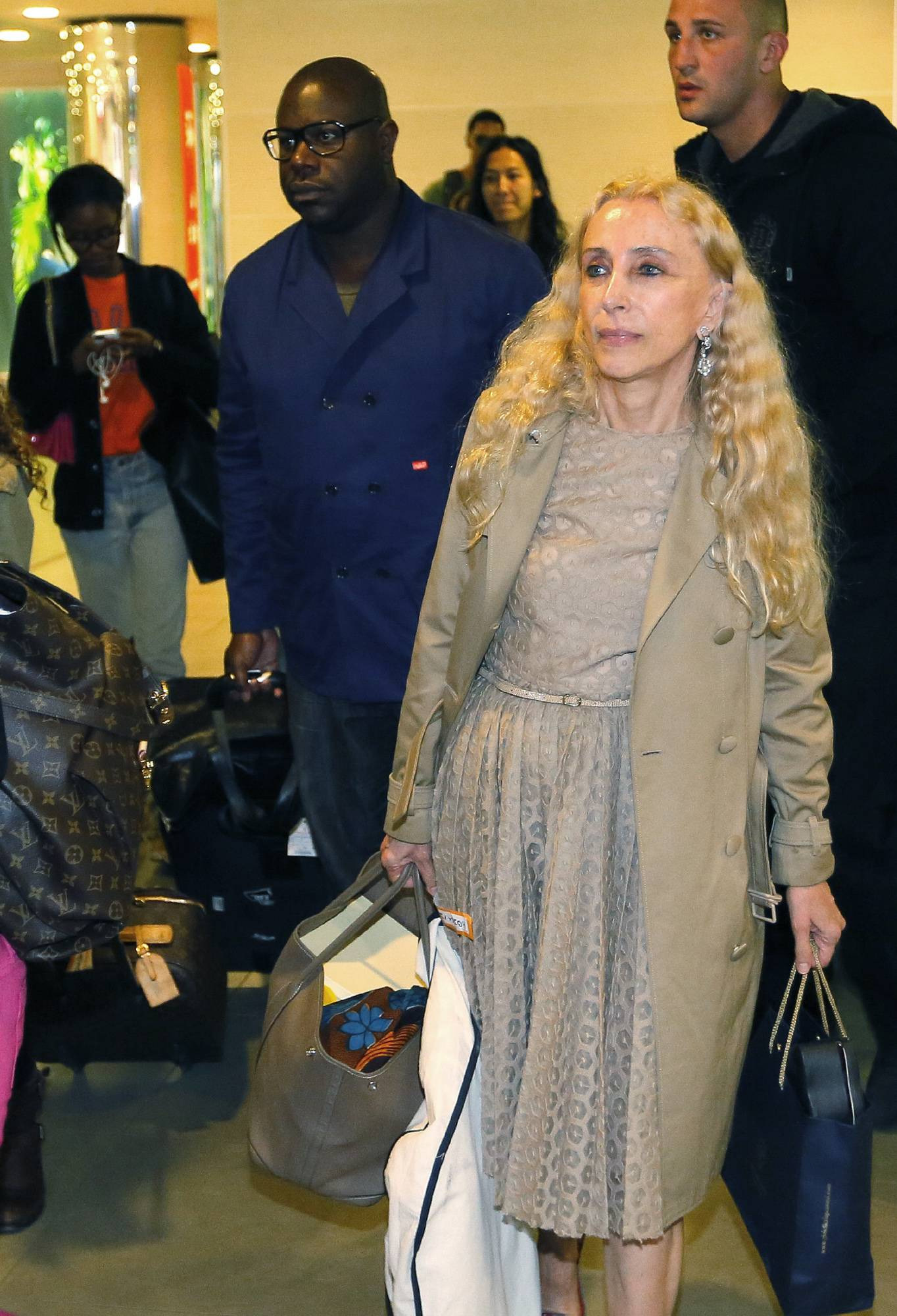 British film director and producer Steve McQueen, left, and Italian journalist and the editor-in-chief of Vogue Italia Franca Sozzani, right, foreground, arrive in Florence, Italy, Saturday, May 24, 2014. Kim Kardashian and Kanye West will wed and host a reception at Florence's imposing 16th-century Belvedere Fort on May 24, according to a spokeswoman at the Florence mayor's office. The couple rented the fort, located next to Florence's famed Boboli Gardens, for $410,000 and a Protestant minister will preside over the ceremony. Belvedere Fort was built in 1590, believed using plans by Don Giovanni de' Medici. Located near the Arno River, it offers a panoramic view of Florence and the surrounding Tuscan hills.
