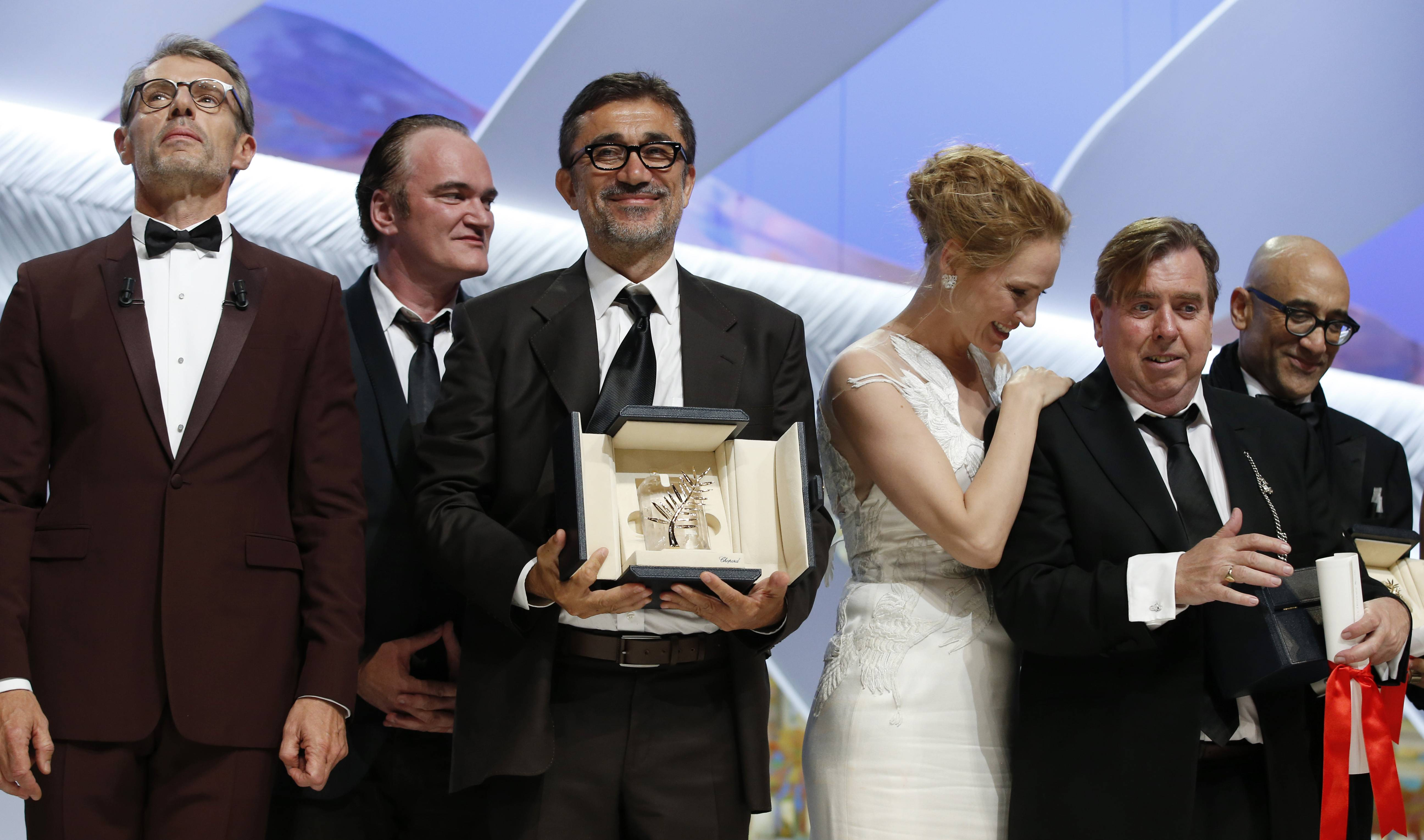 "Director Nuri Bilge Ceylan, center, poses with the Palme d'Or award Saturday for the film ""Winter Sleep"" and actor Timothy Spall, second right, poses with his award for Best Actor for his role in the film ""Mr. Turner"" during the awards ceremony for the 67th international film festival, Cannes, southern France."