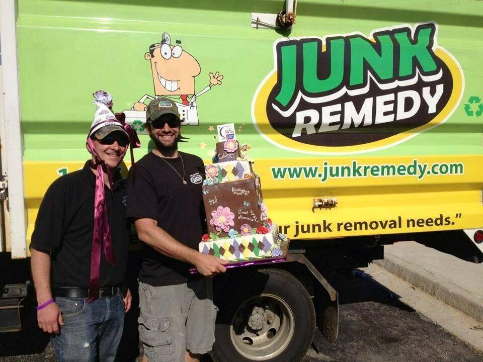 Two Junk Remedy employees celebrate a birthday while on the job.